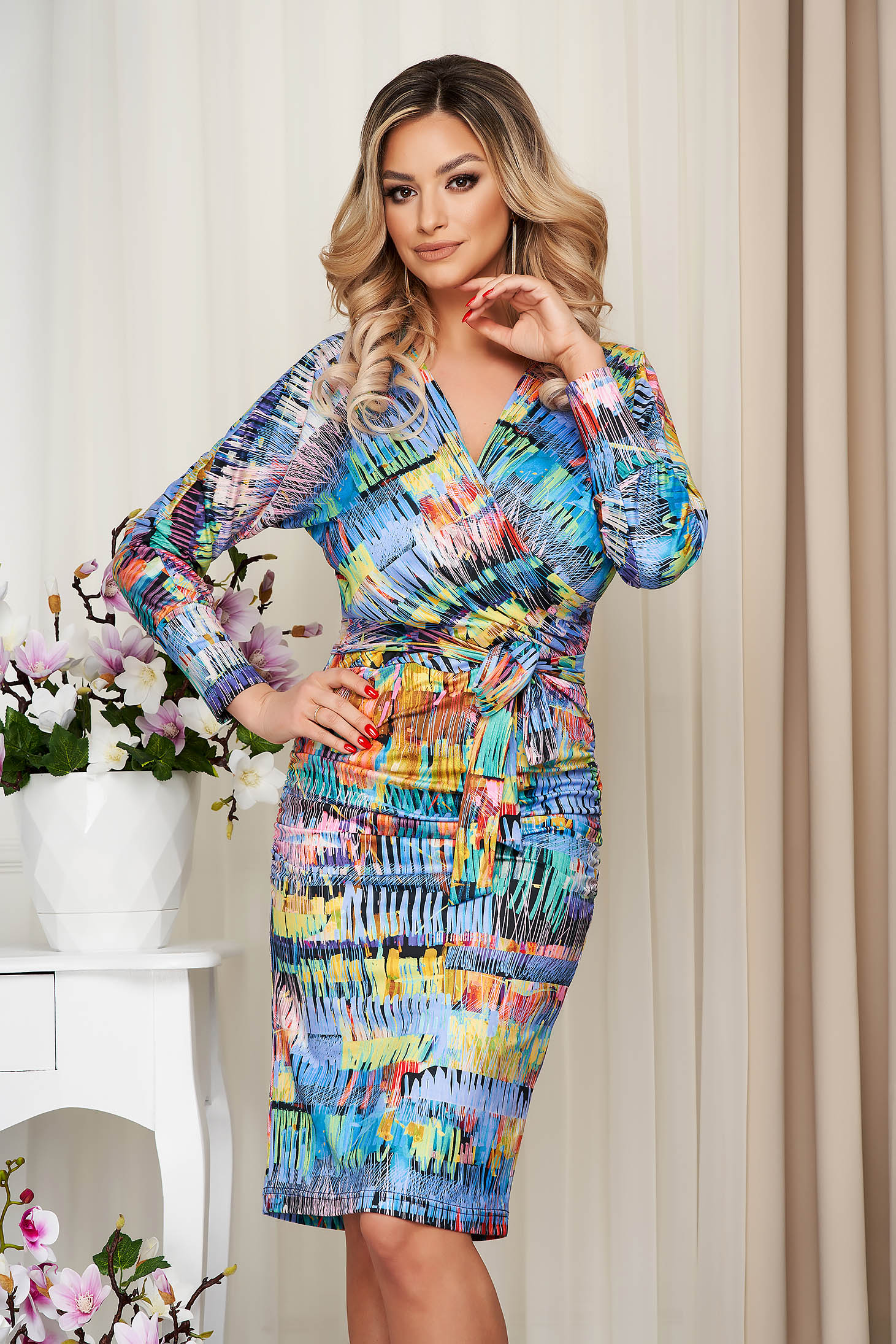 Dress pencil from elastic and fine fabric wrap over front with graphic details