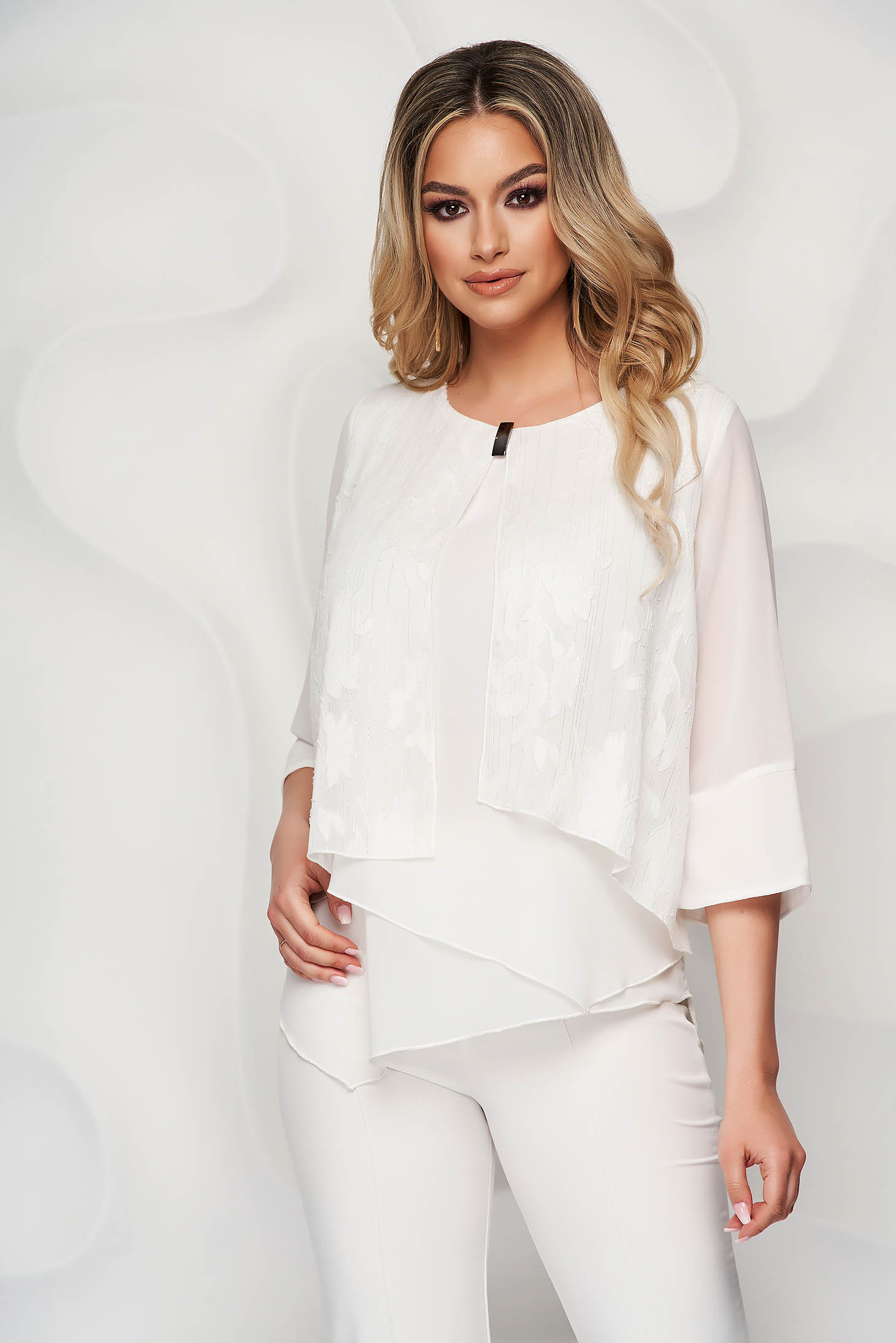 White women`s blouse from veil fabric asymmetrical raised seams
