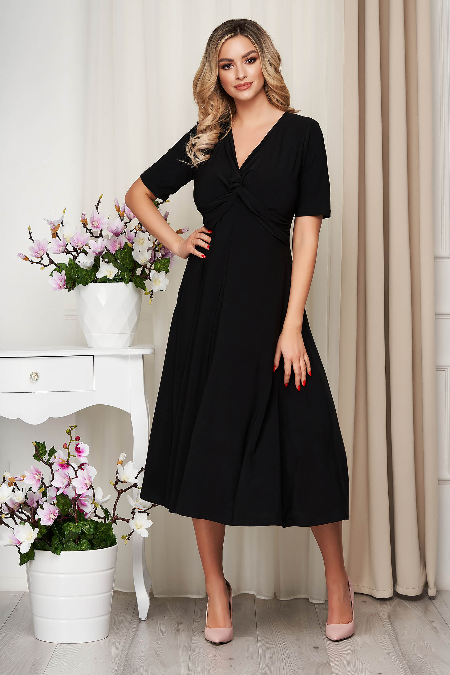 Black dress a-line from elastic fabric with deep cleavage