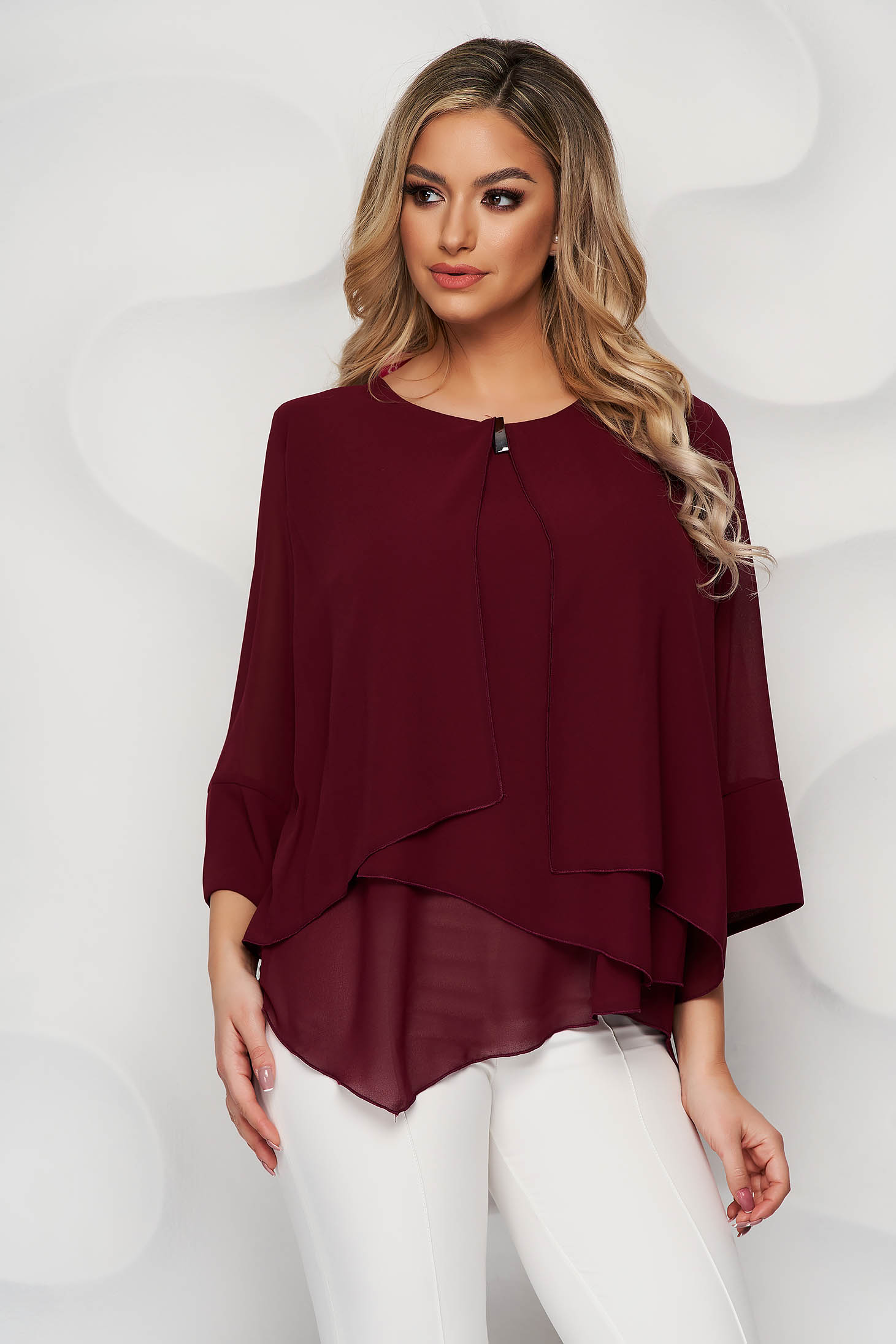 Burgundy office asymmetrical loose fit women`s blouse short cut from veil fabric with metal accessories