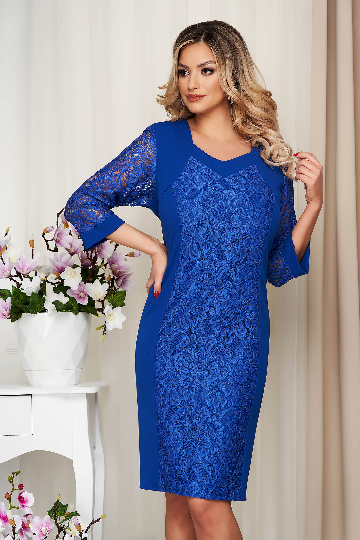 Blue dress pencil from elastic fabric with lace details