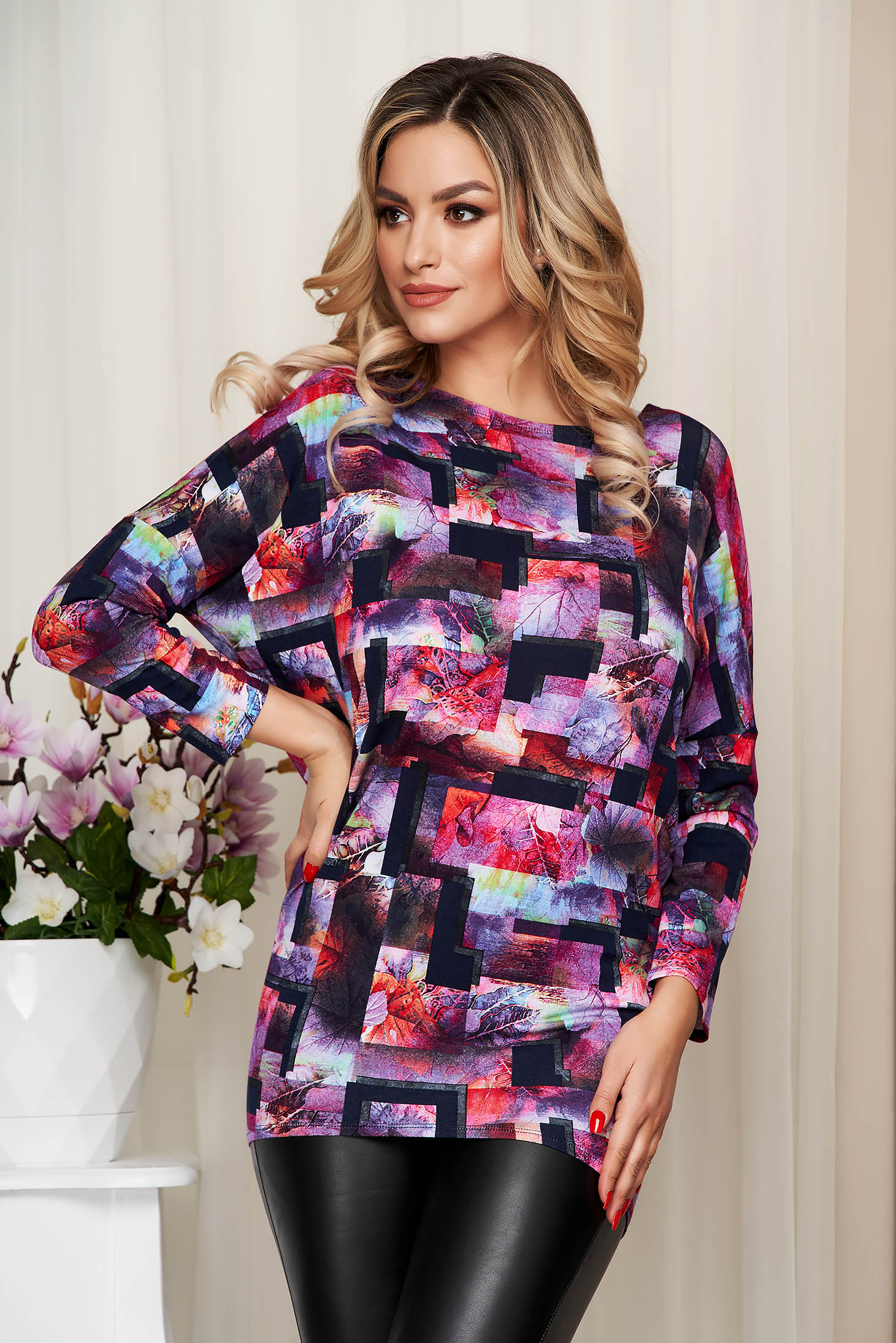 Women`s blouse from elastic and fine fabric loose fit with graphic details