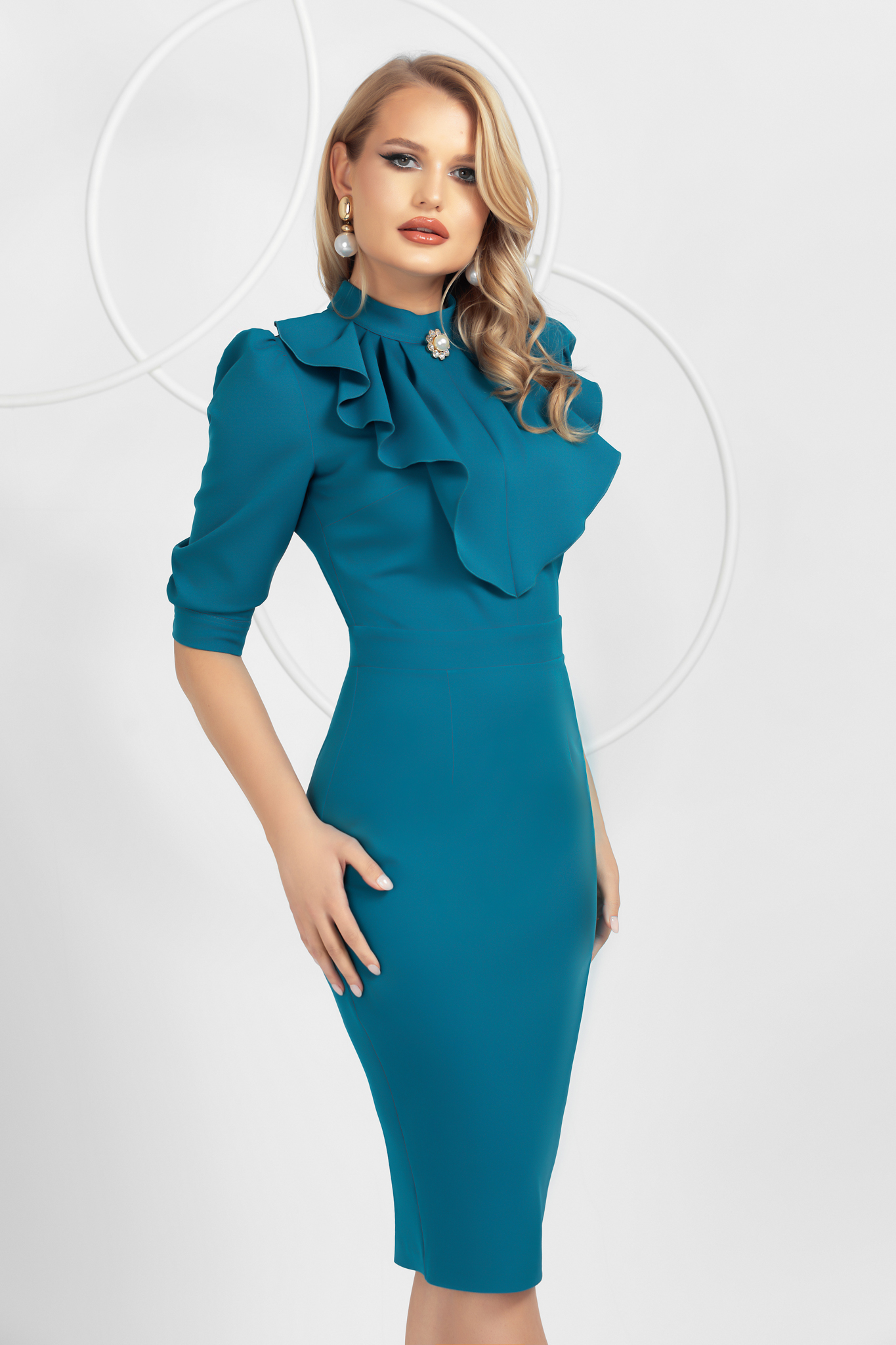 Turquoise slightly elastic fabric pencil dress with ruffle details accessorized with breastpin