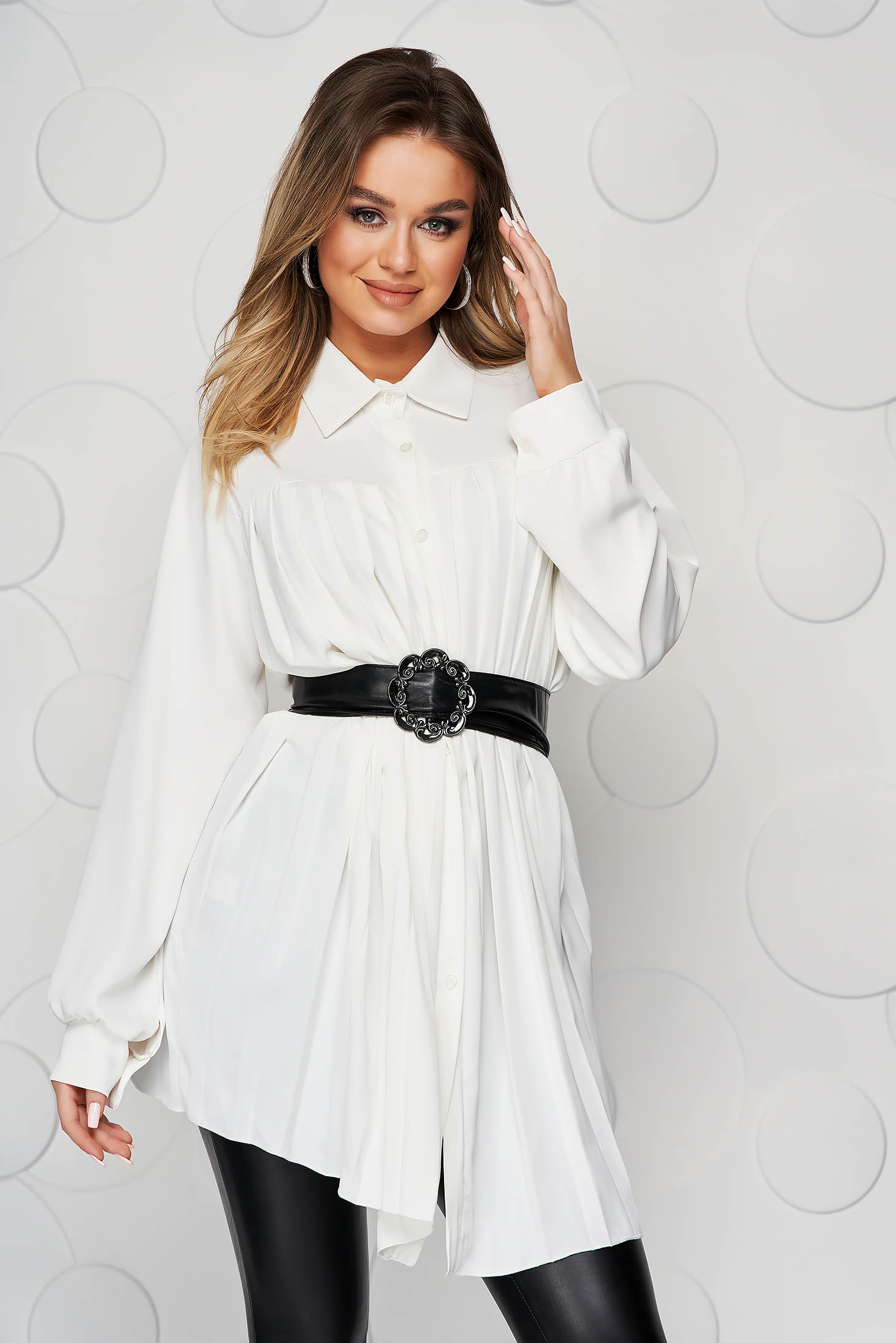 White women`s shirt transparent chiffon fabric folded up faux leather belt