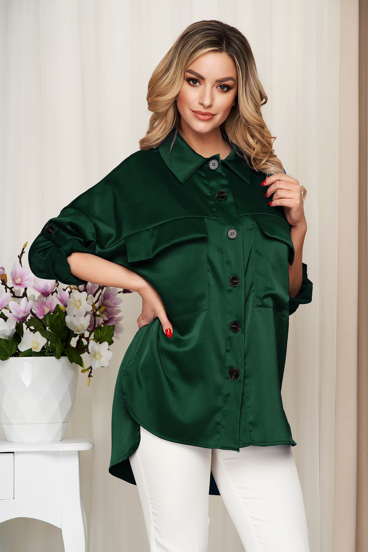 Green women`s shirt from satin nonelastic fabric loose fit
