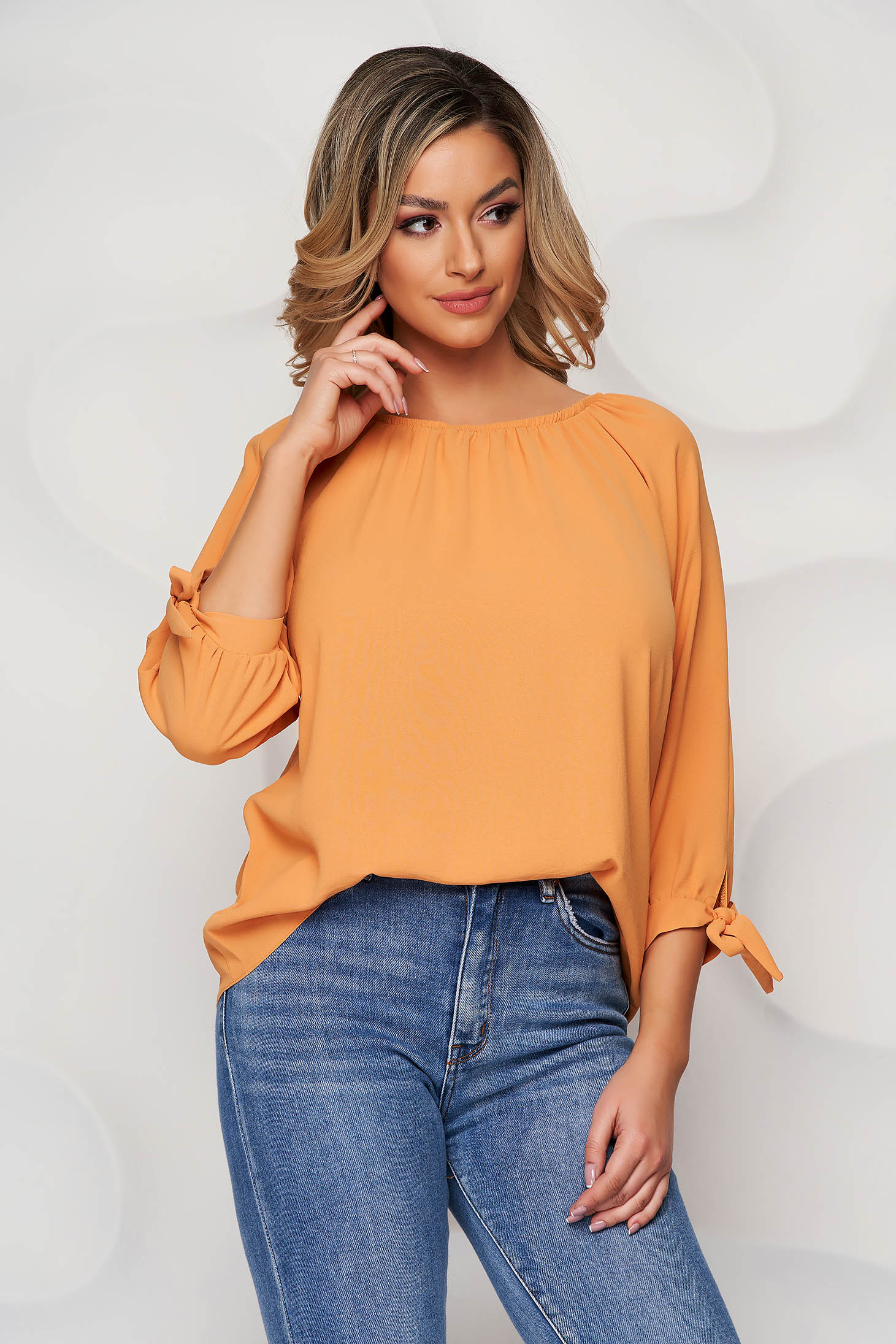 Women`s blouse mustard on the shoulders slightly transparent fabric with bow accessories
