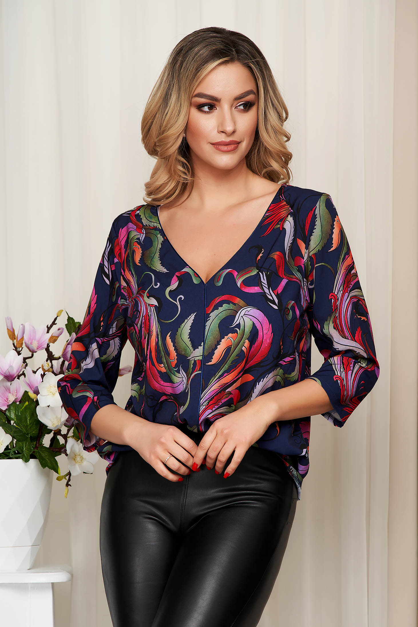 Women`s blouse coral with floral print v back neckline thin fabric
