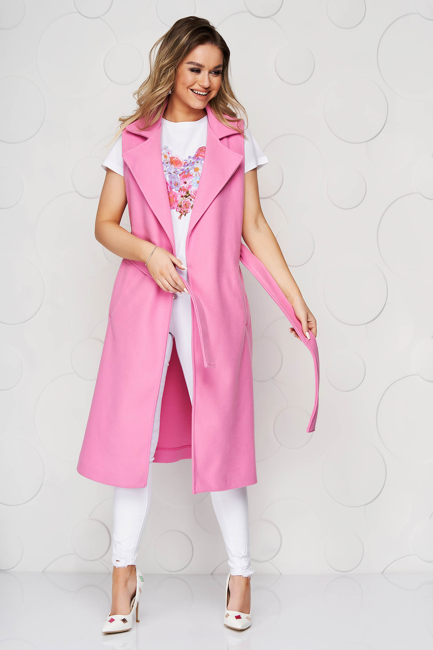 Pink gilet accessorized with tied waistband detachable cord