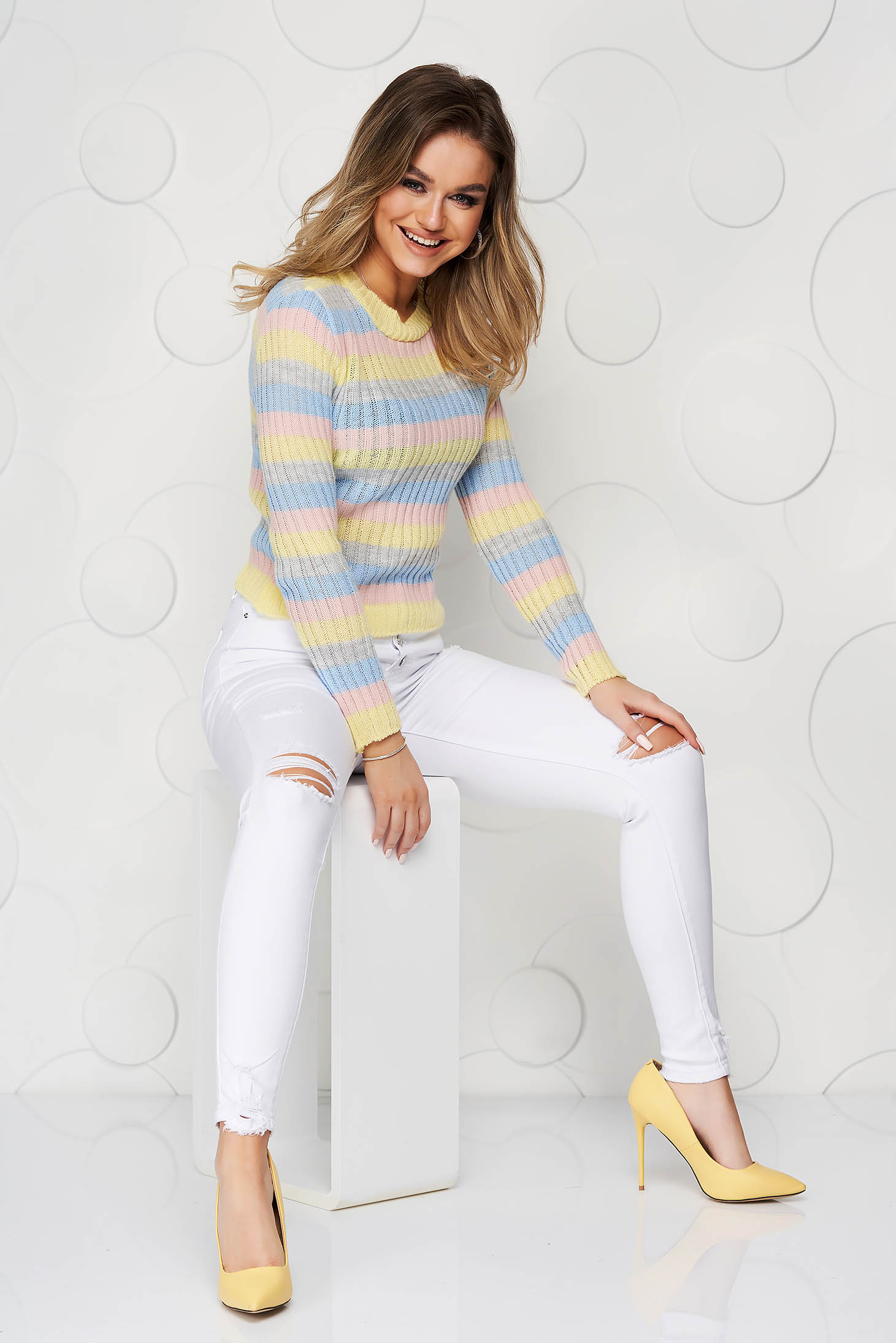 Yellow sweater from elastic fabric from striped fabric tented knitted