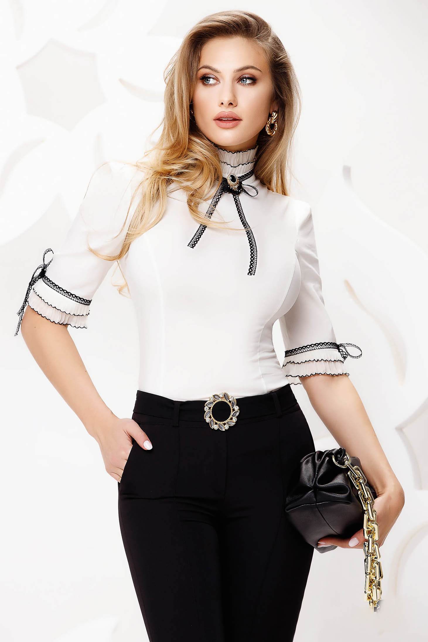 White women`s shirt elegant tented with turtle neck with bow accessorized with breastpin