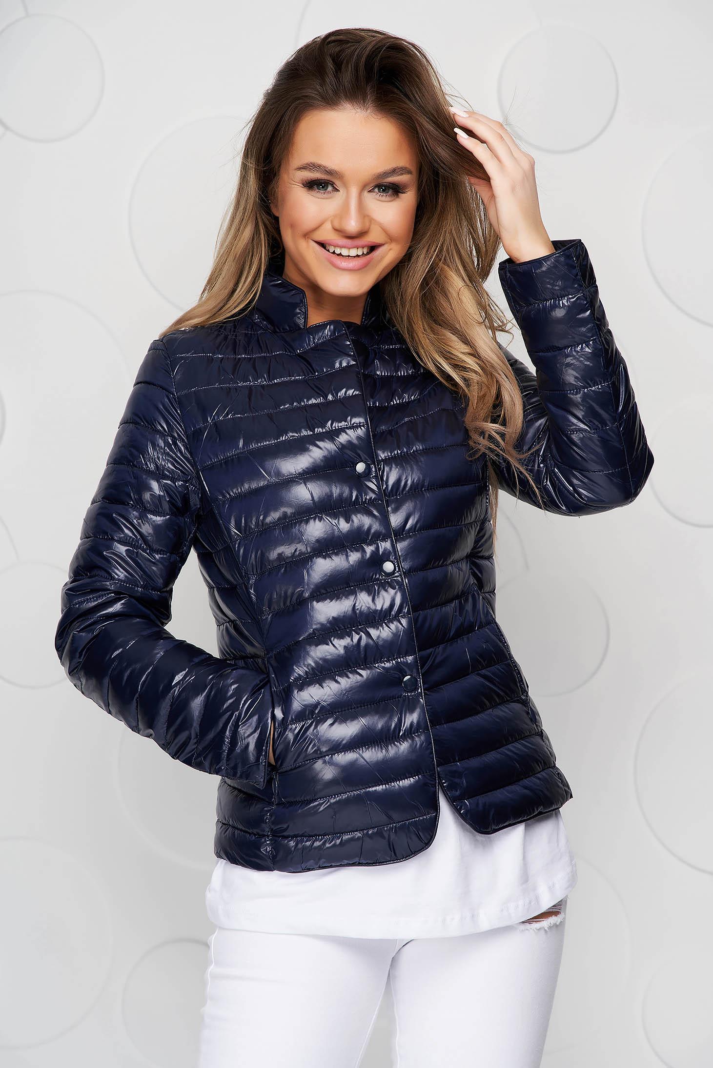 Darkblue jacket tented from slicker metal eyelets fastening