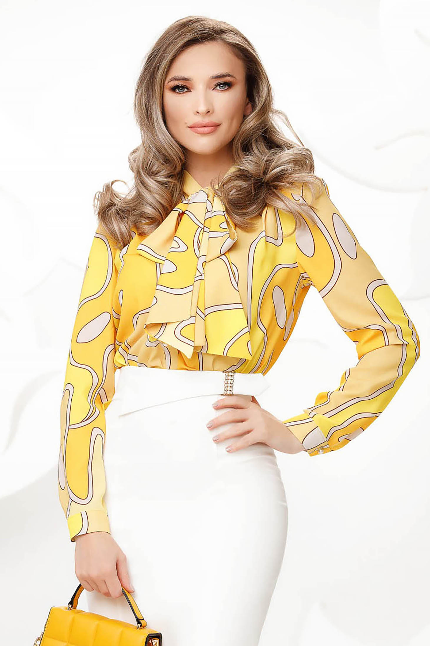 Yellow women`s blouse from veil fabric bow accessory