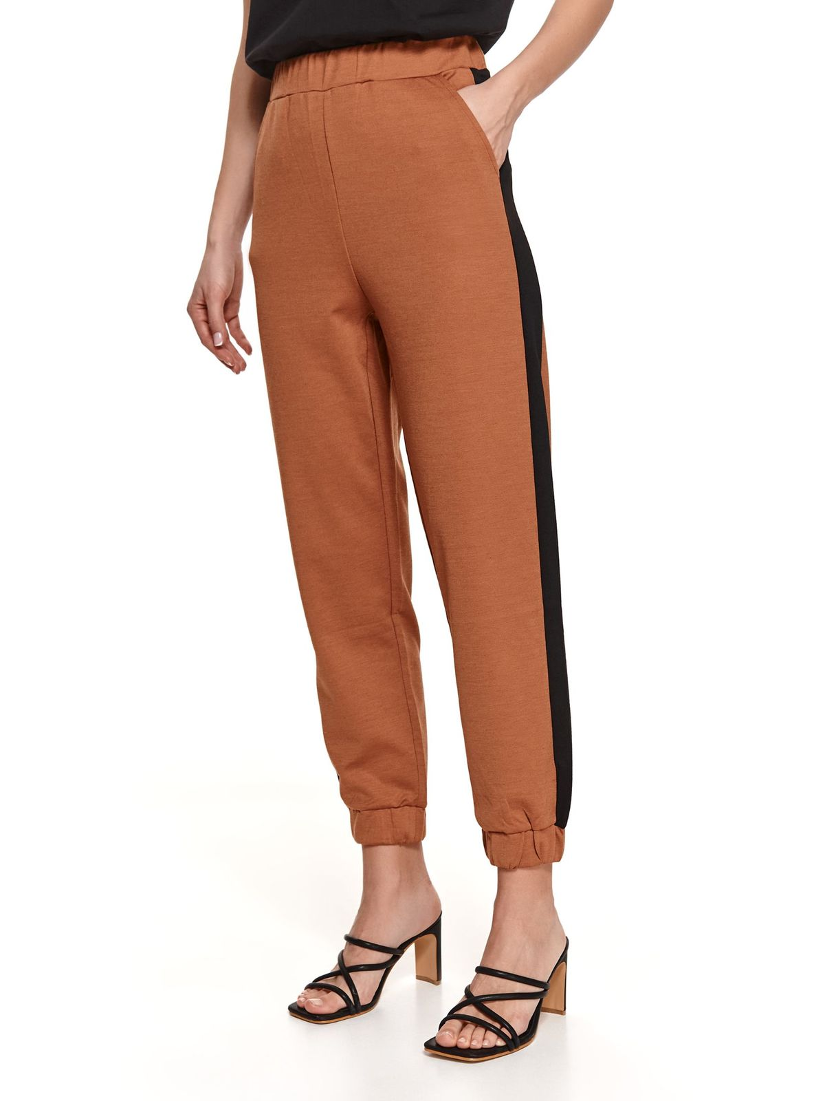 Lightbrown trousers conical with front pockets with vertical stripes