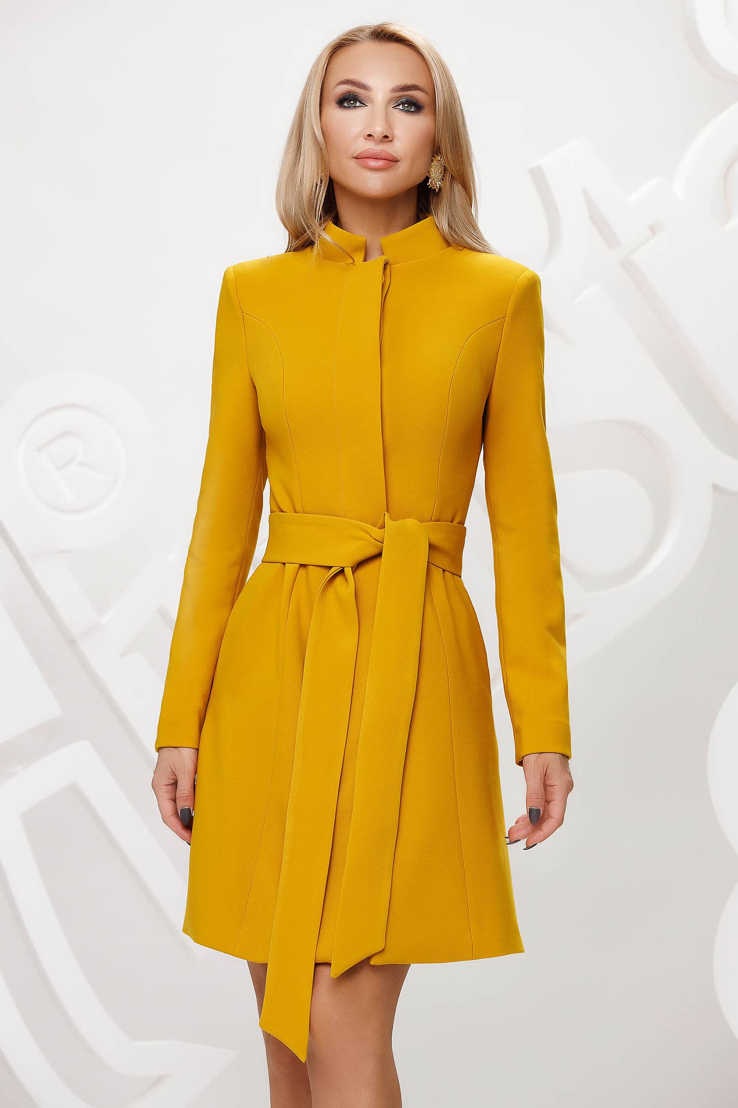Mustard trenchcoat tented short cut elegant accessorized with tied waistband bow accessory