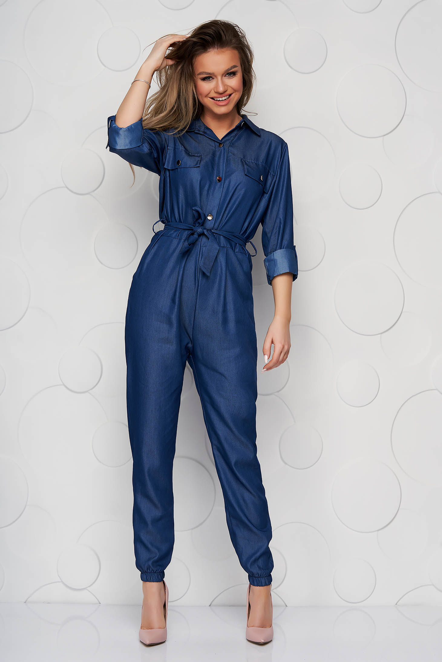 Blue jumpsuit accessorized with tied waistband with elastic waist denim