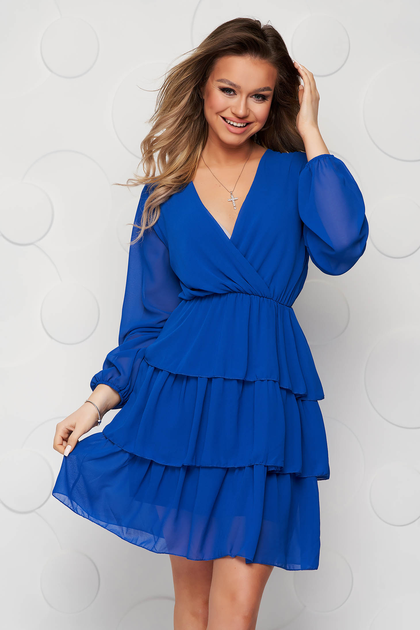 Blue dress cloche with elastic waist from veil fabric with ruffle details short lining under the skirt