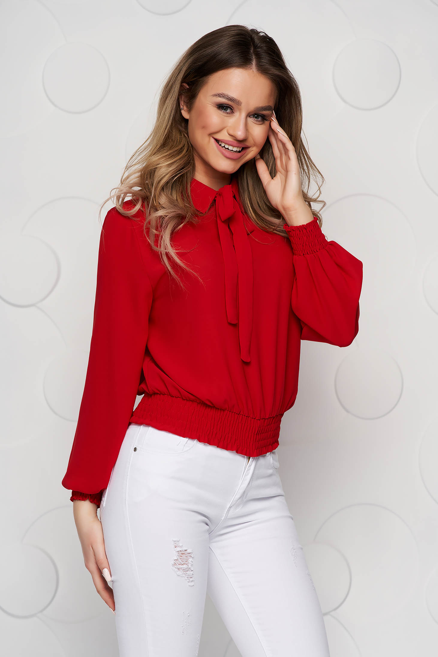 Red women`s blouse from veil fabric with elastic waist