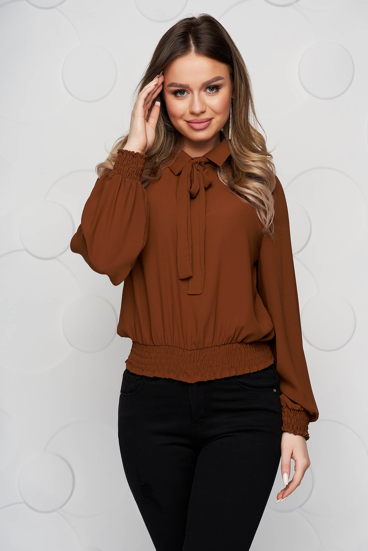 Brown women`s blouse from veil fabric with elastic waist