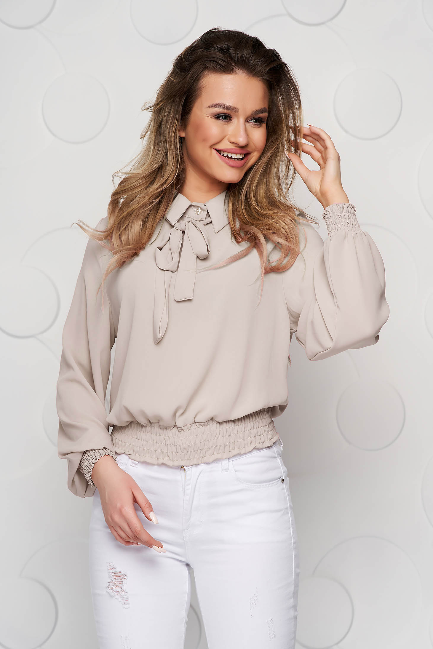 Cream women`s blouse from veil fabric with elastic waist