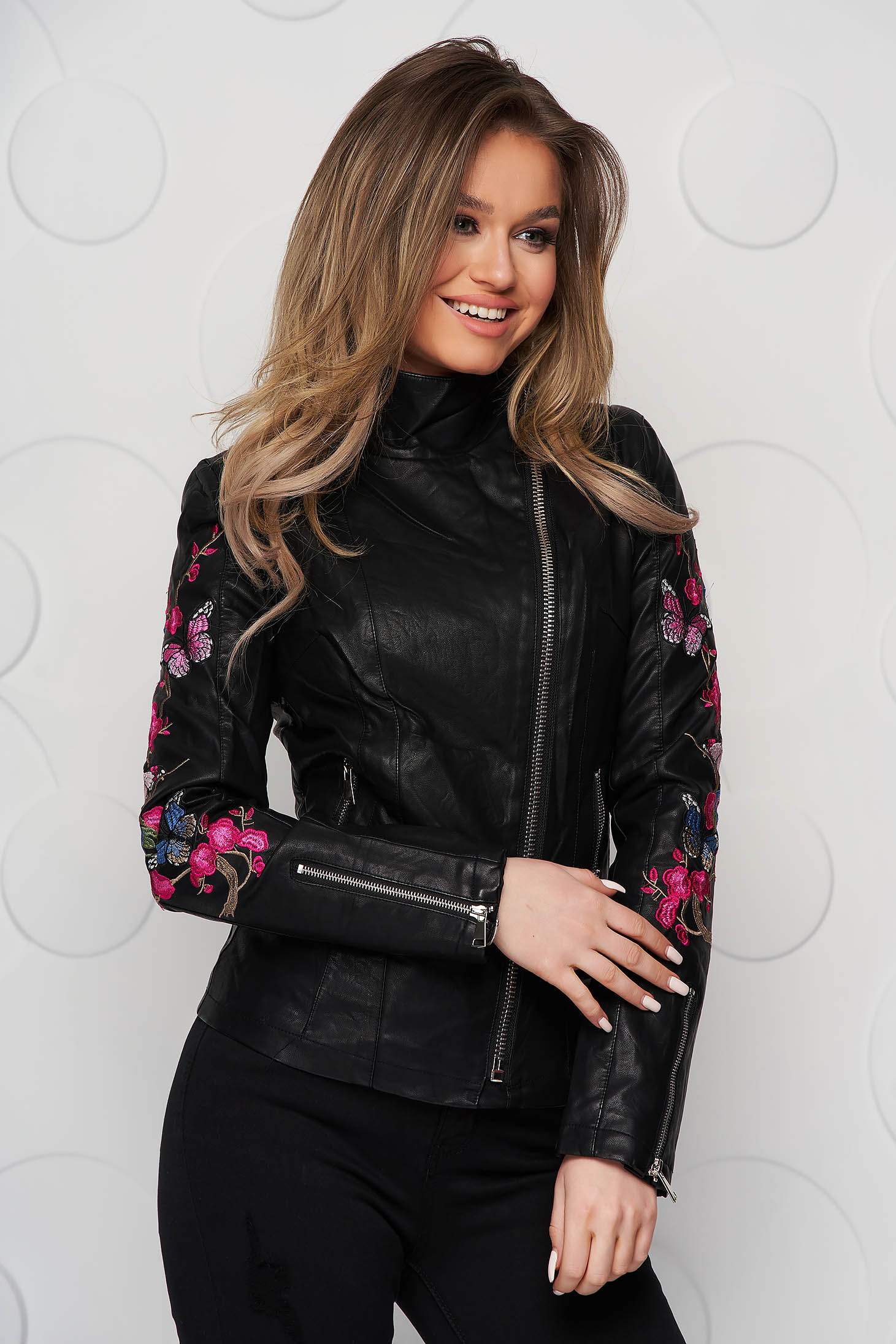 Black jacket from ecological leather tented with embroidery details with turtle neck