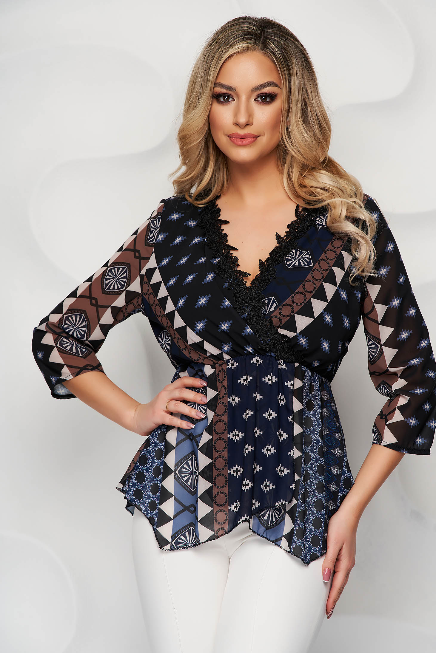 Blue women`s blouse with graphic details from veil fabric with elastic waist with deep cleavage with lace details