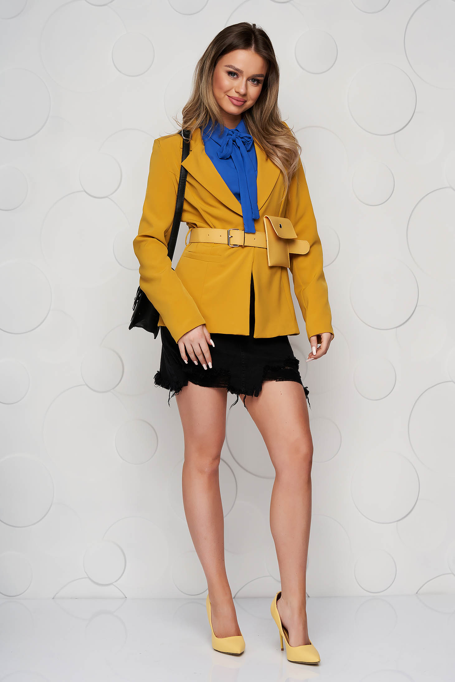 Mustard jacket tented accessorized with belt purse