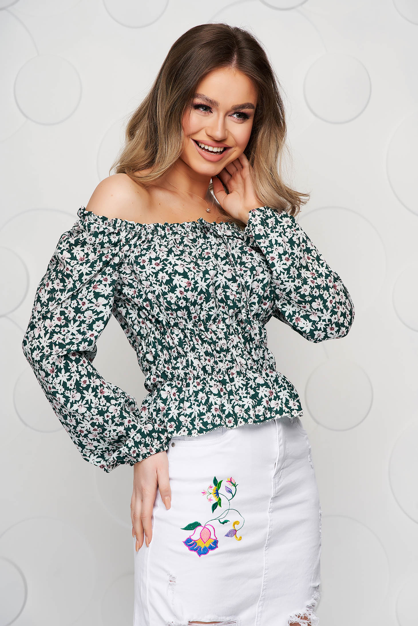 Green women`s blouse with floral print from veil fabric with elastic waist elastic cleavage