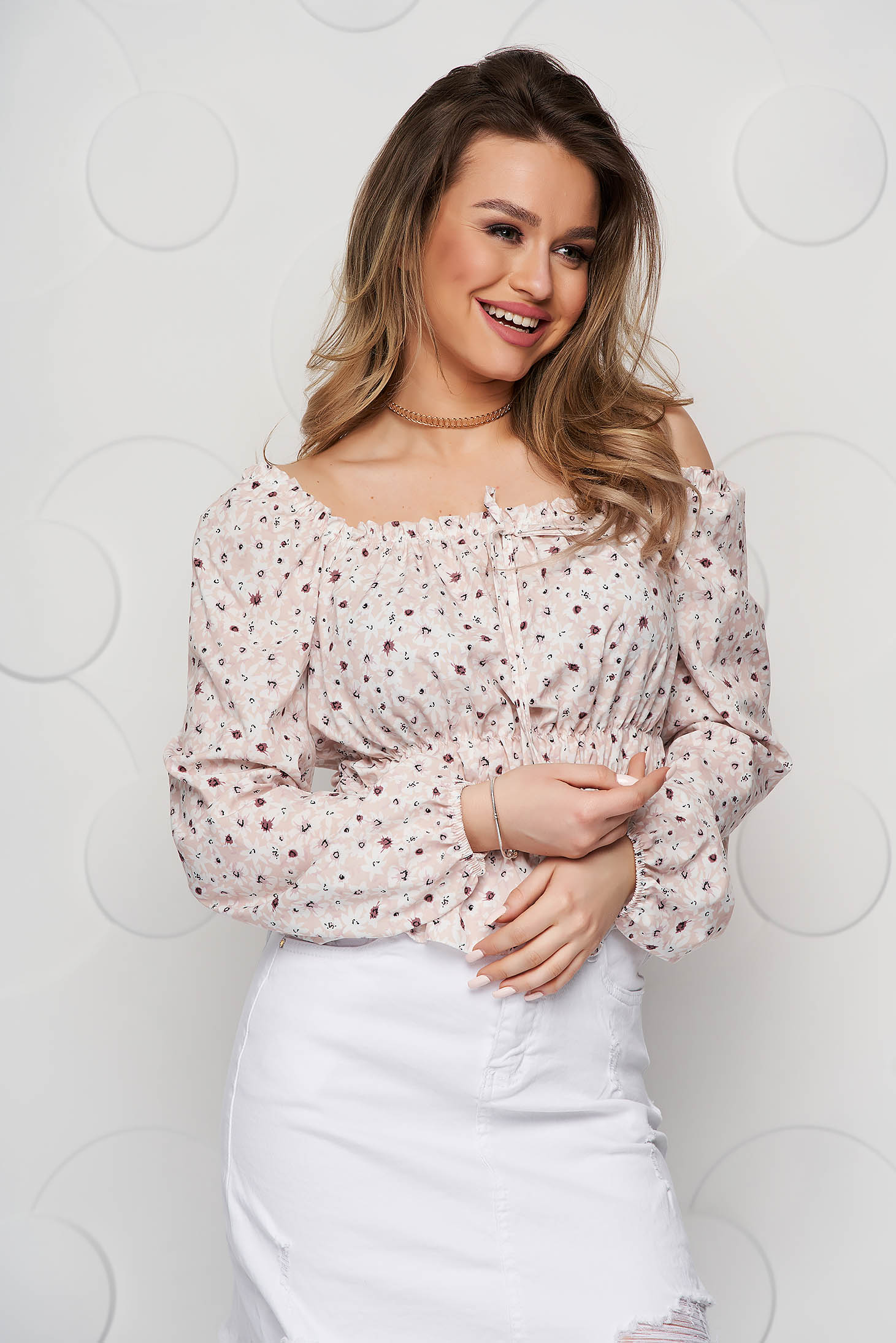 Cream women`s blouse with floral print from veil fabric with elastic waist elastic cleavage