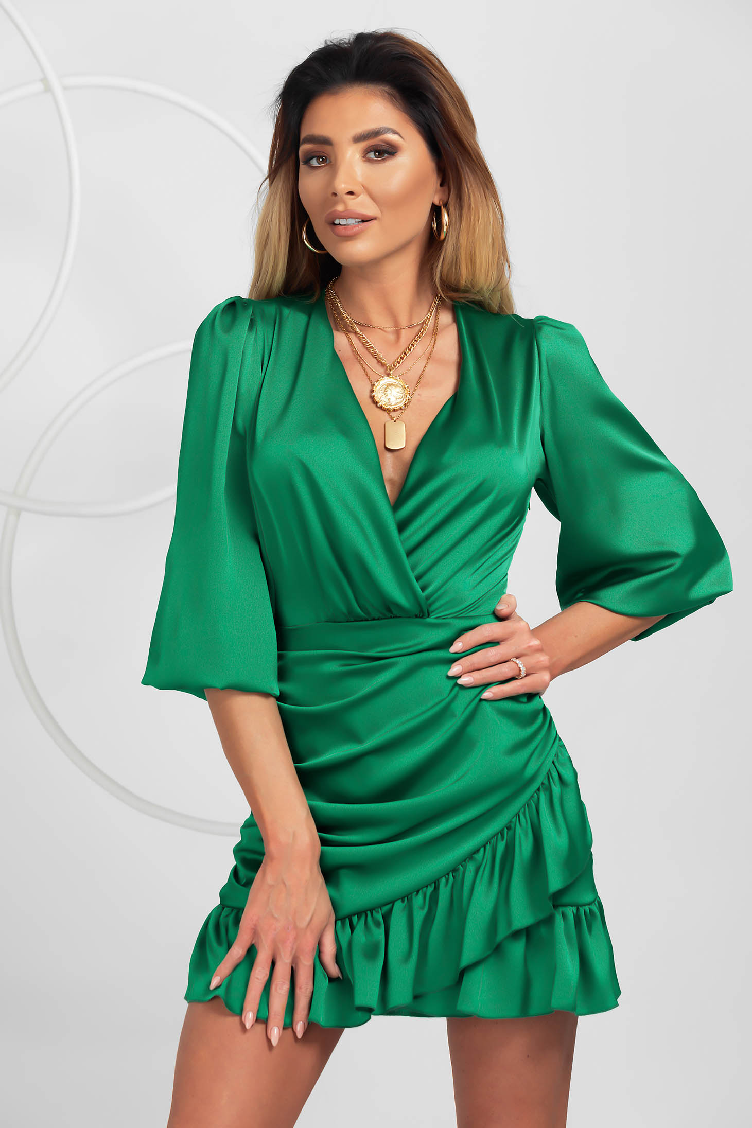 Green dress from satin clubbing wrap over front with ruffle details