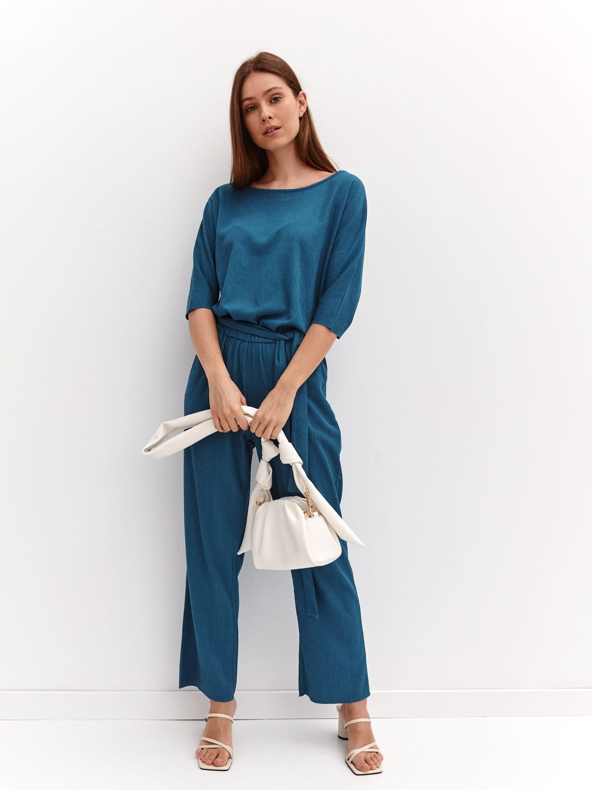 Flared airy fabric accessorized with tied waistband turquoise jumpsuit