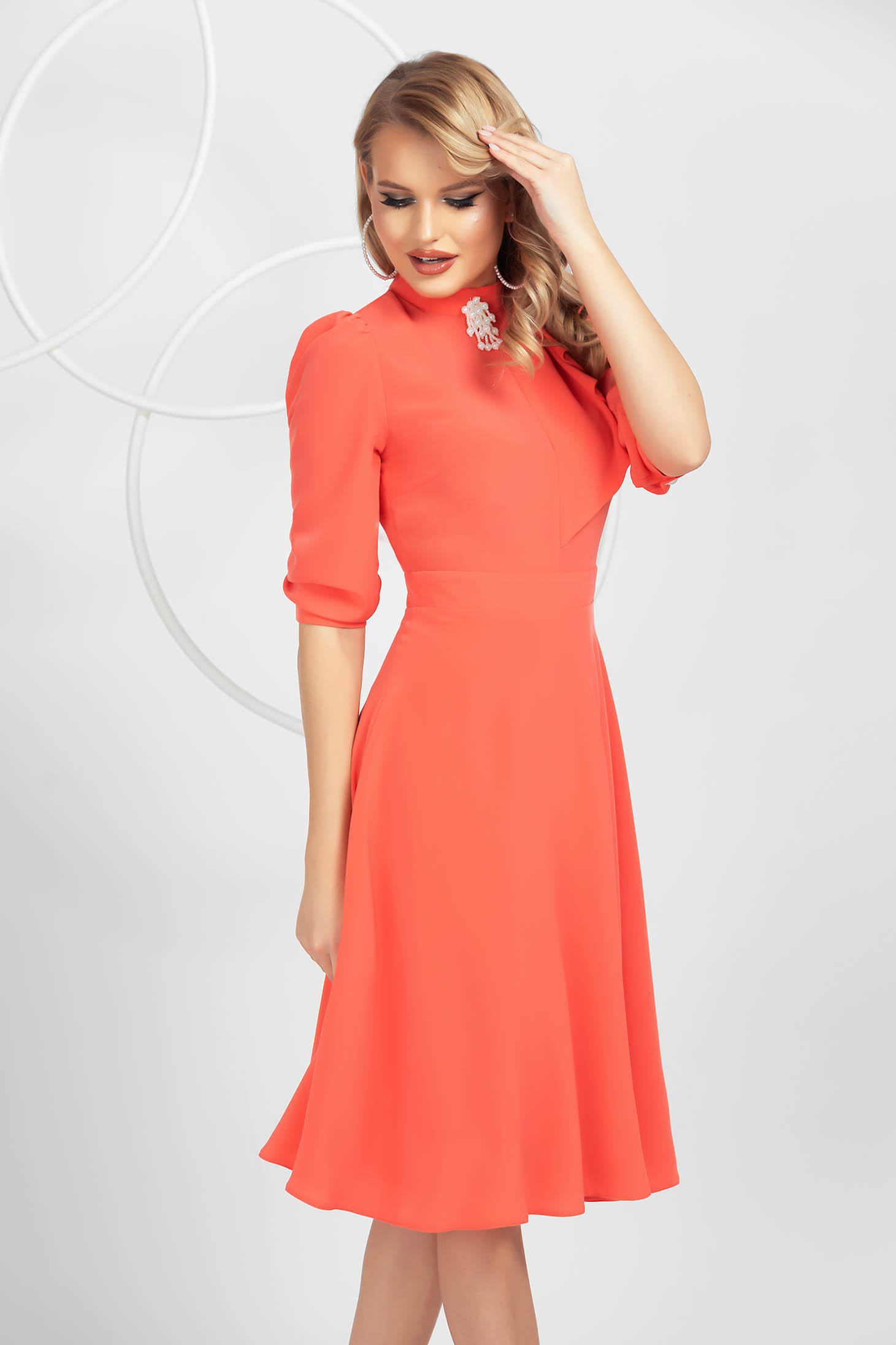 Coral dress from veil fabric cloche accessorized with breastpin