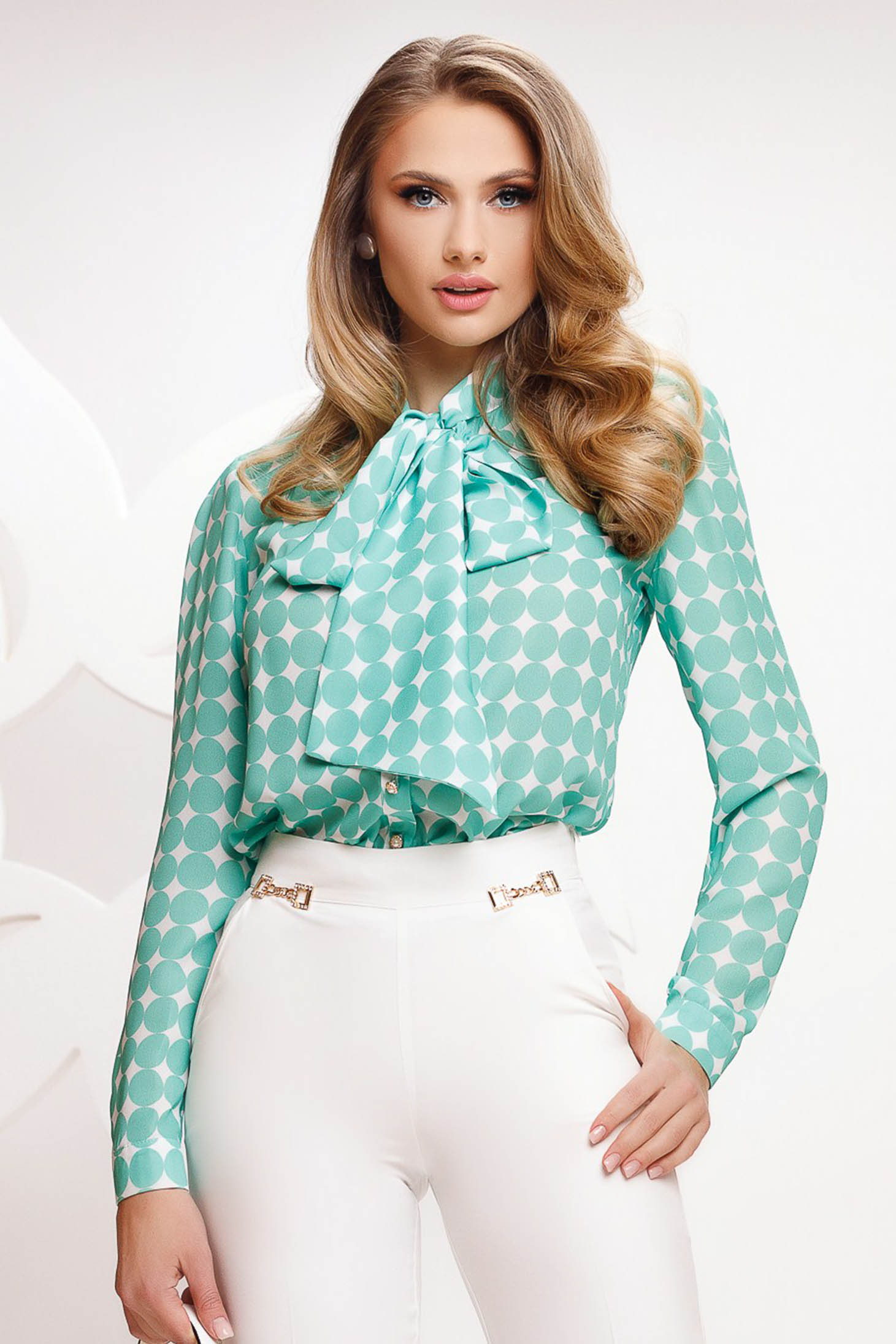 Green women`s blouse dots print from veil fabric loose fit tied with bow
