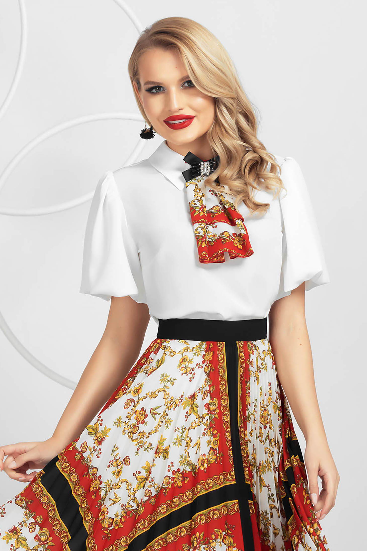 Women`s blouse from veil slightly elastic fabric with puffed sleeves accessorized with breastpin