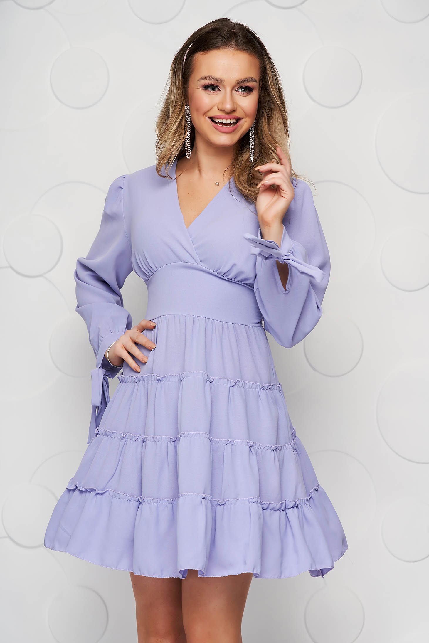 Lila dress with ruffle details cloche wrap over front