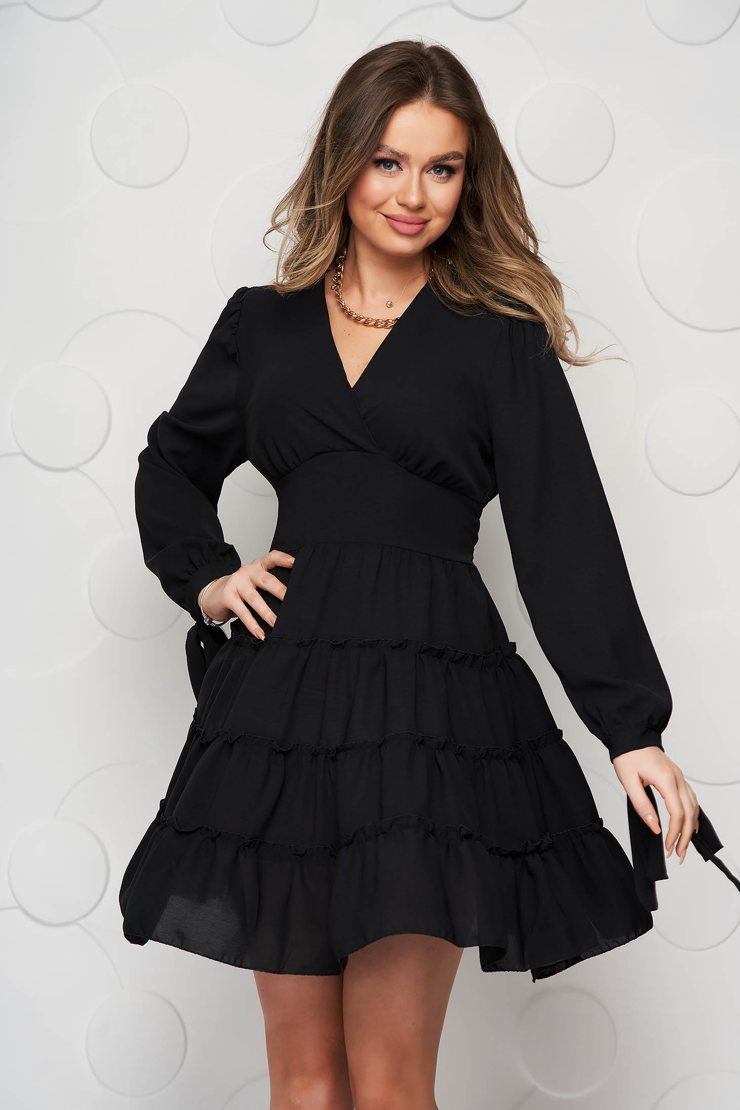 Black dress with ruffle details cloche wrap over front
