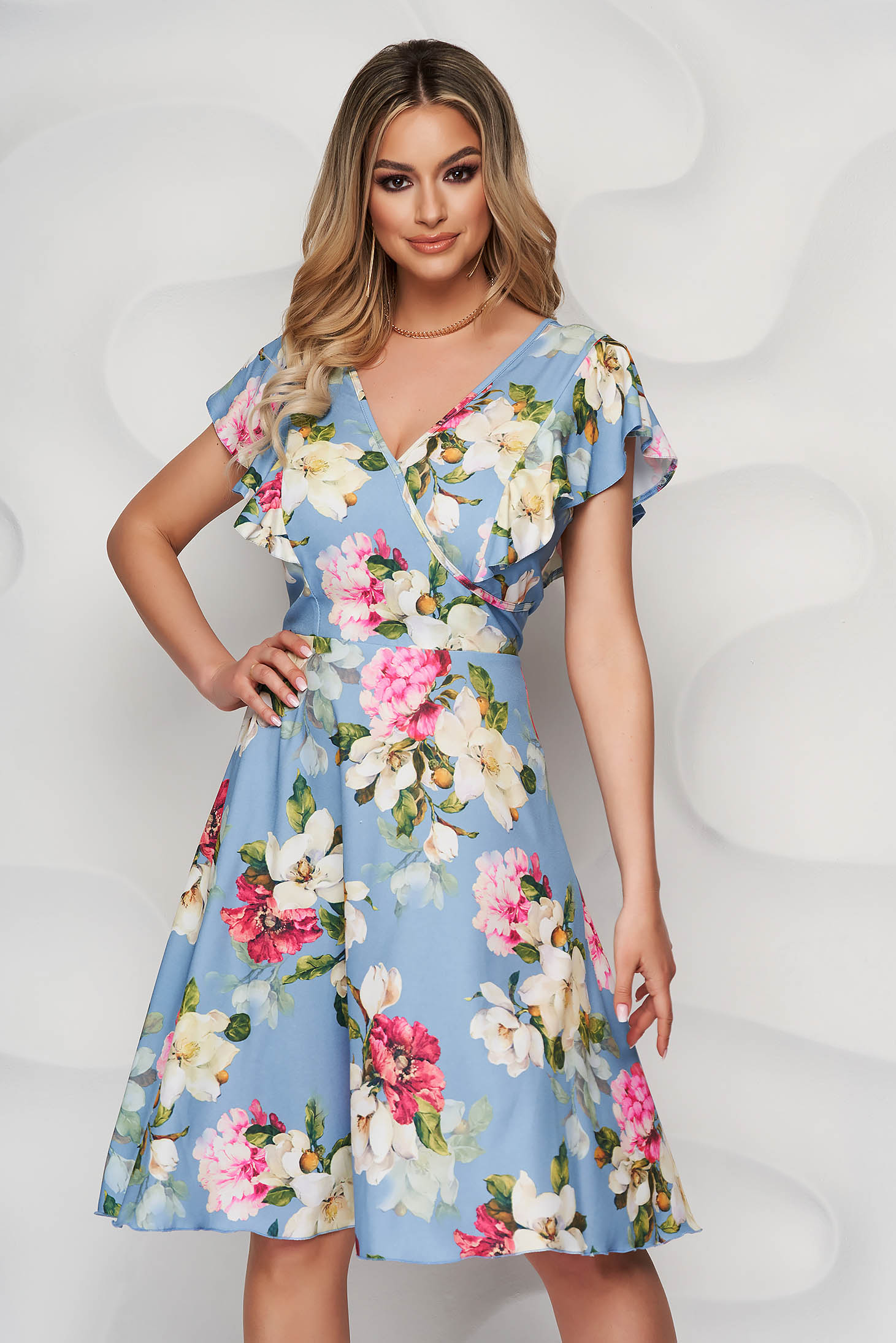 Lightblue dress with floral print cloche wrap over front with ruffle details