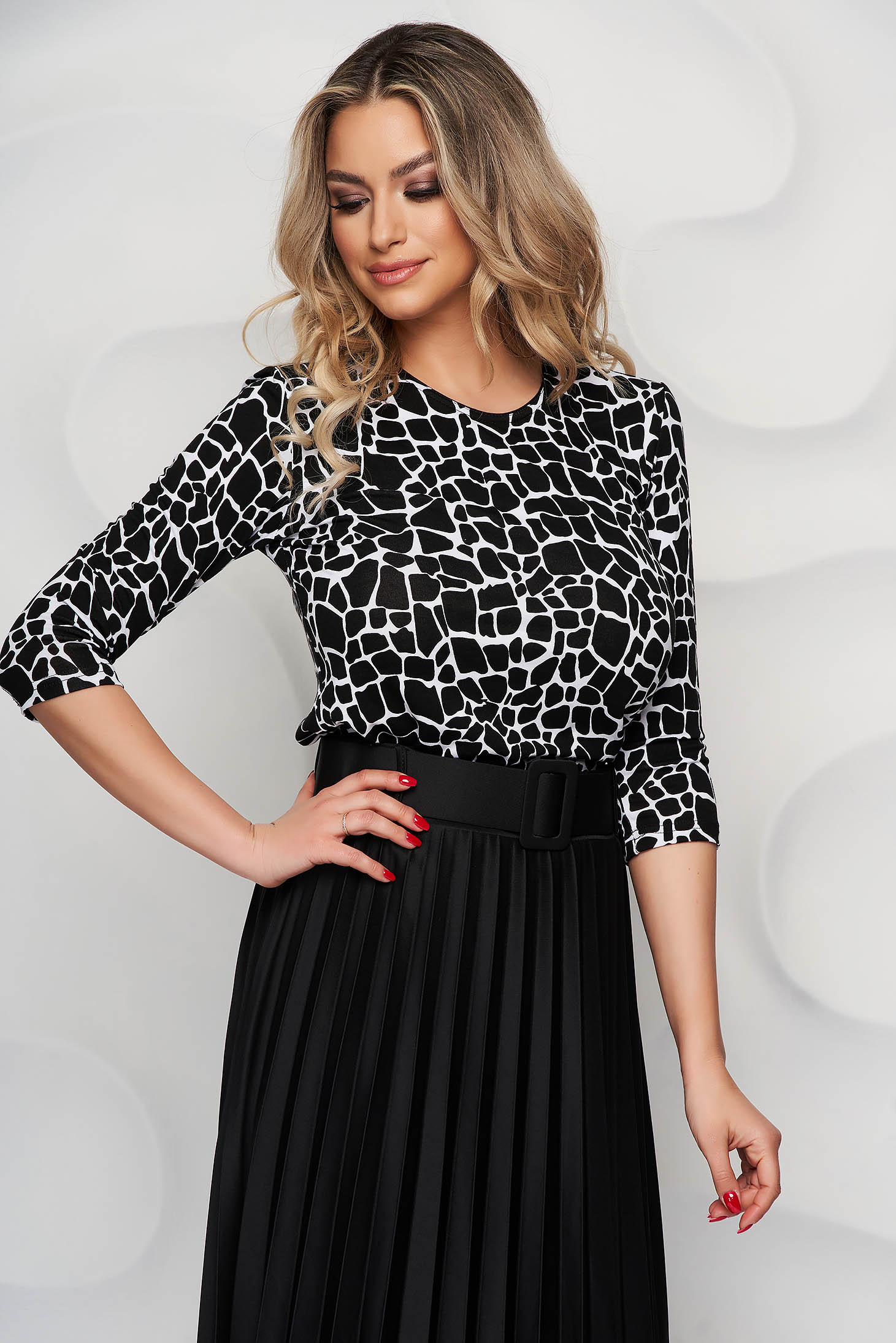 Women`s blouse from elastic and fine fabric with rounded cleavage loose fit