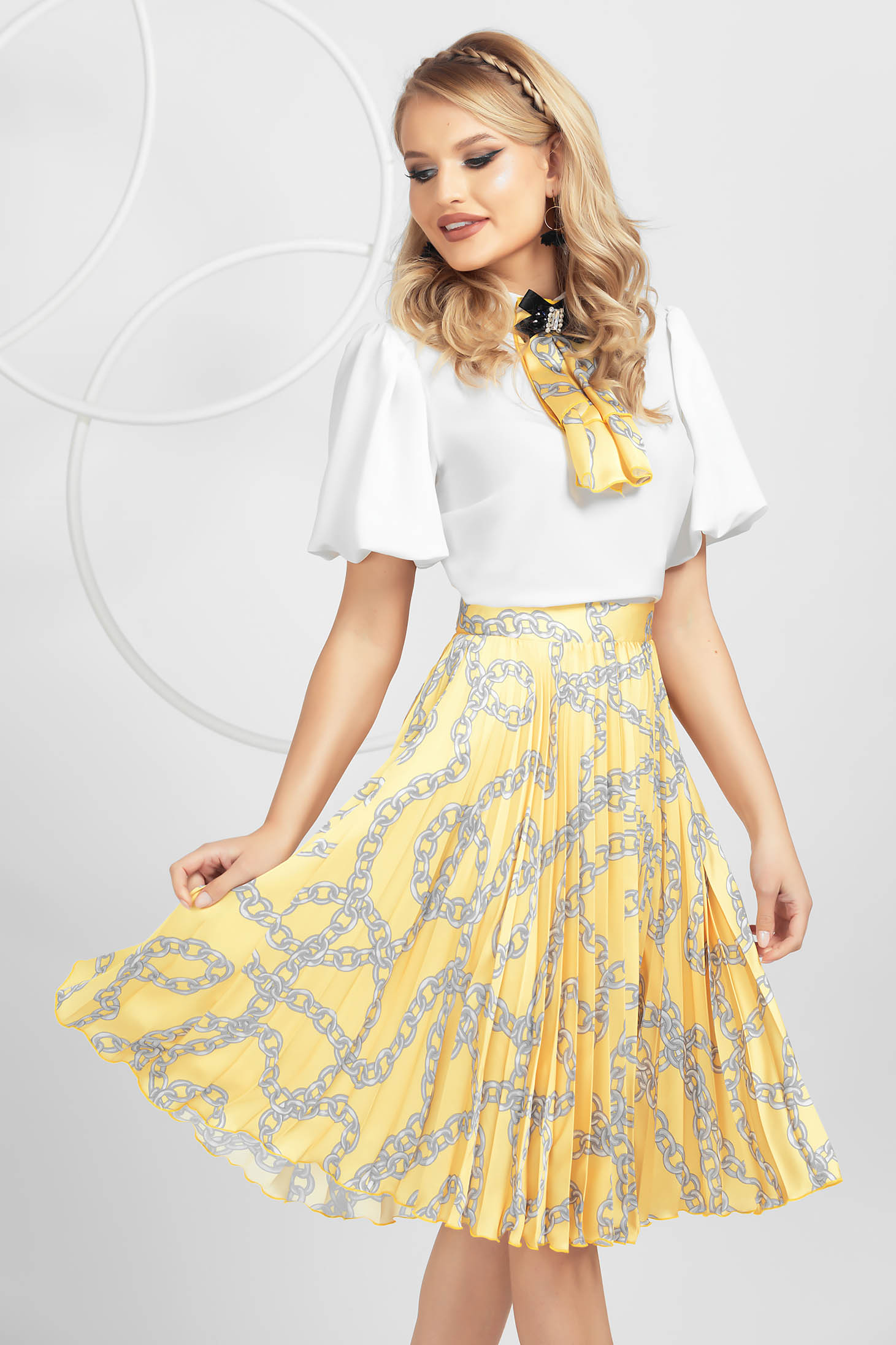 Yellow skirt airy fabric with floral print with elastic waist pleats of material