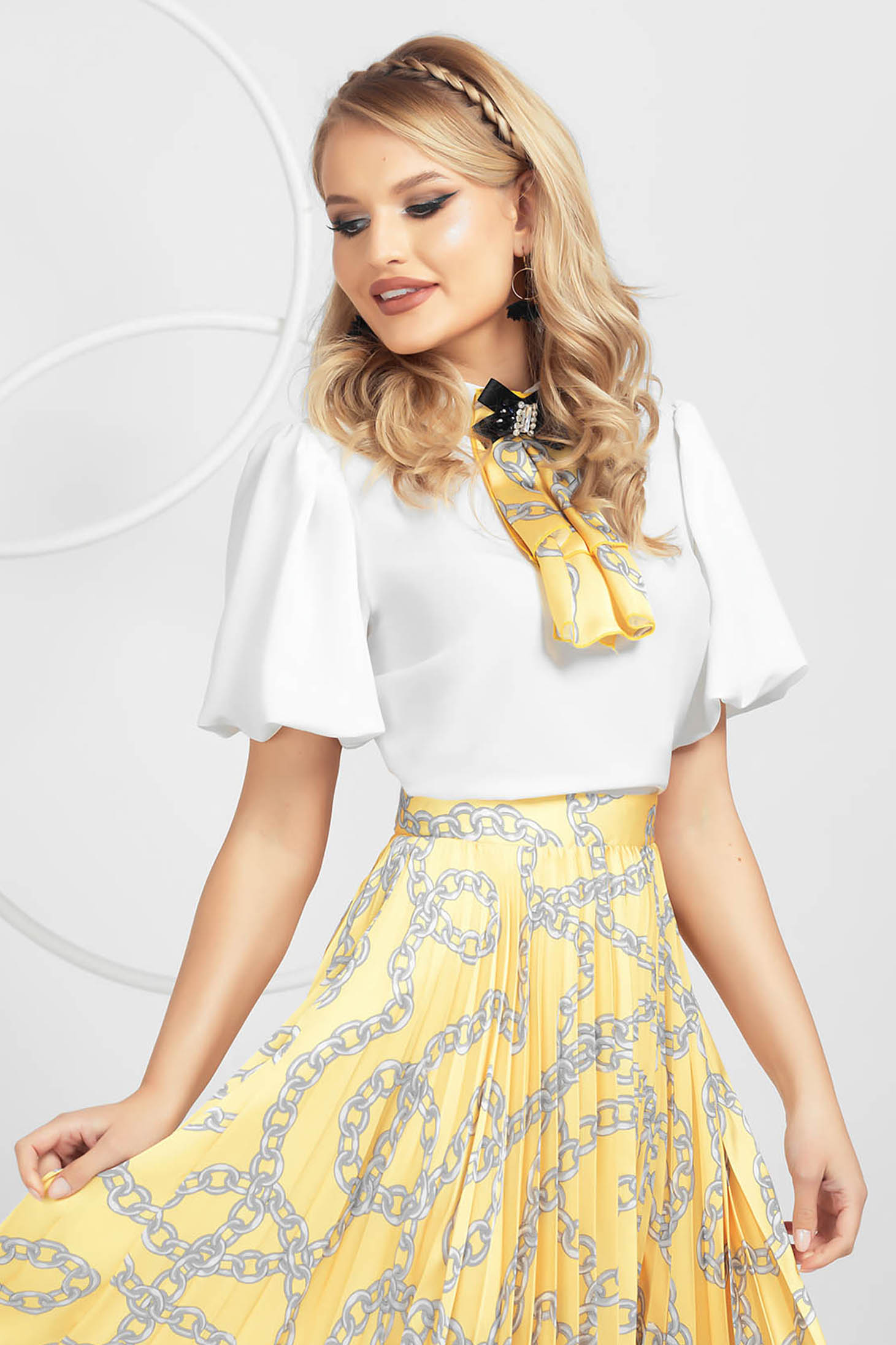 Ivory women`s blouse from veil slightly elastic fabric with puffed sleeves accessorized with breastpin