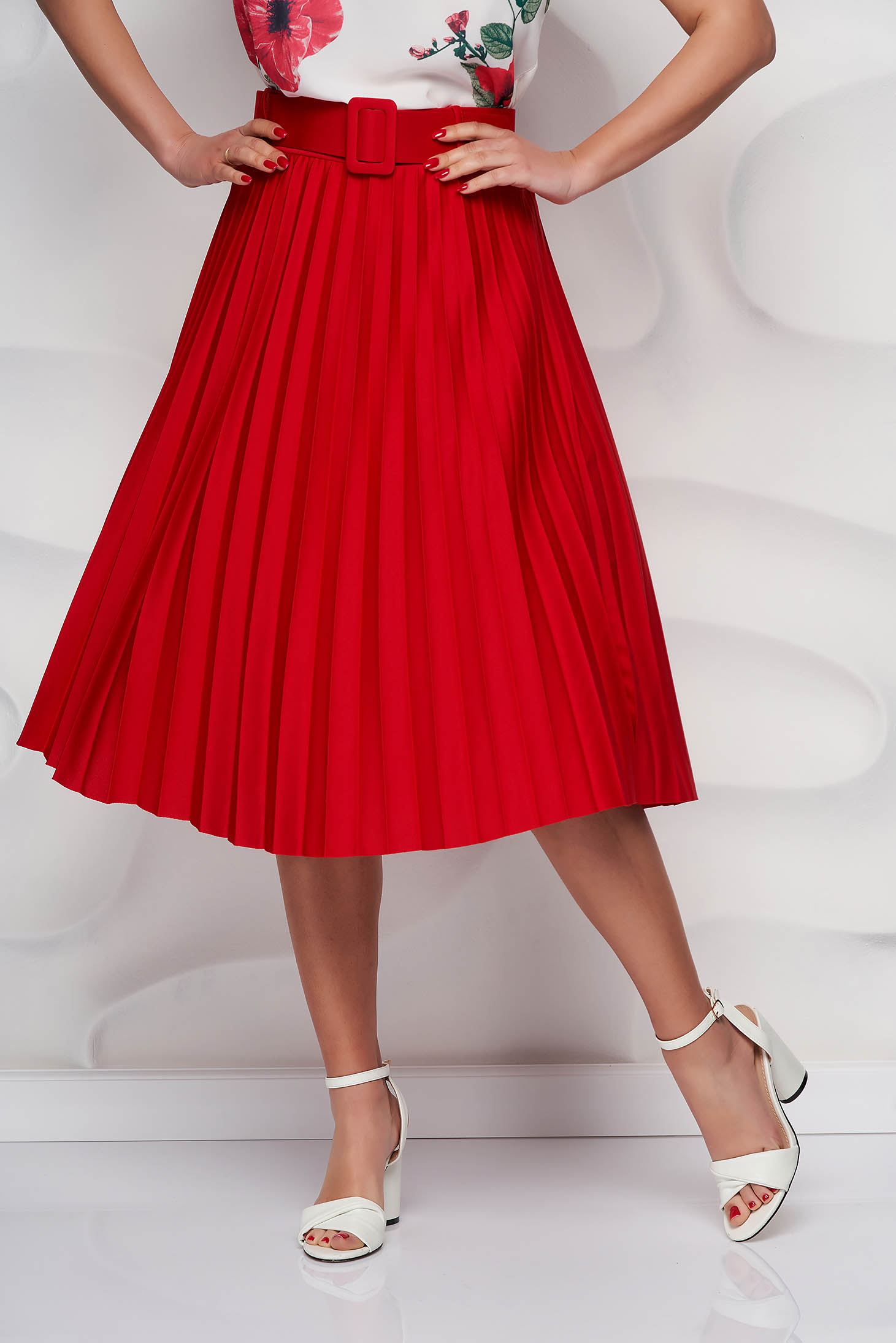 Red skirt cloche accessorized with belt slightly elastic fabric folded up