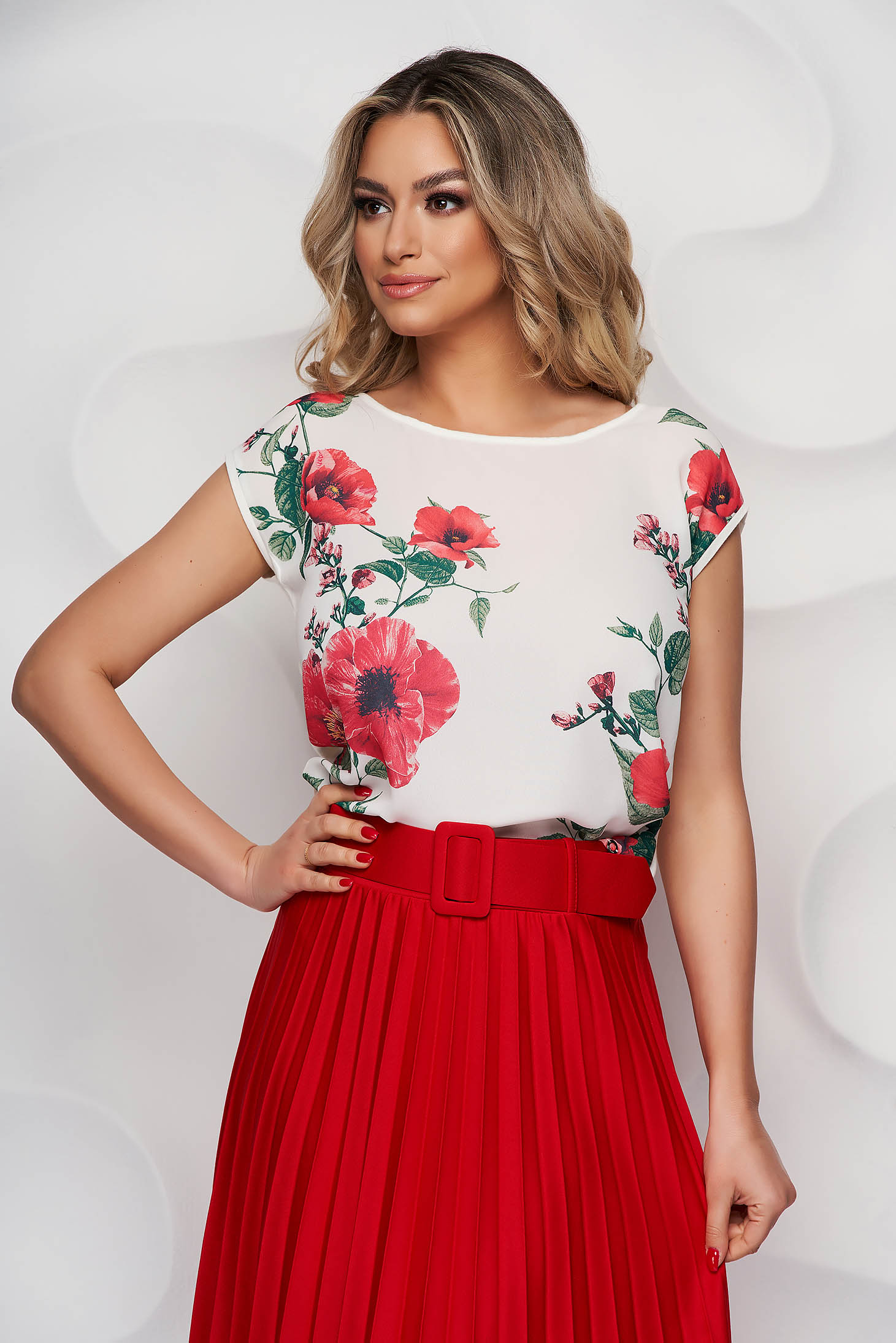 White women`s blouse elegant with floral print thin fabric with rounded cleavage