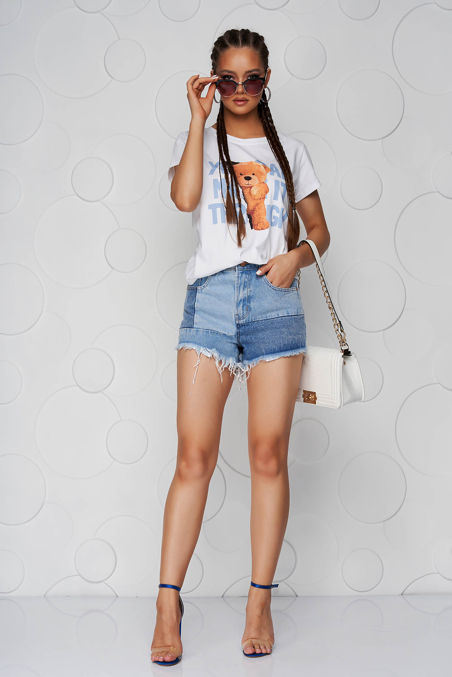 Blue short denim high waisted tented with fringes at the bottom