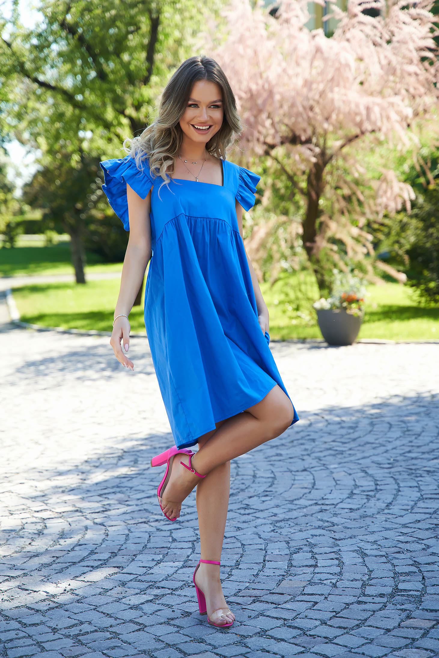 Blue dress loose fit with ruffle details with deep cleavage