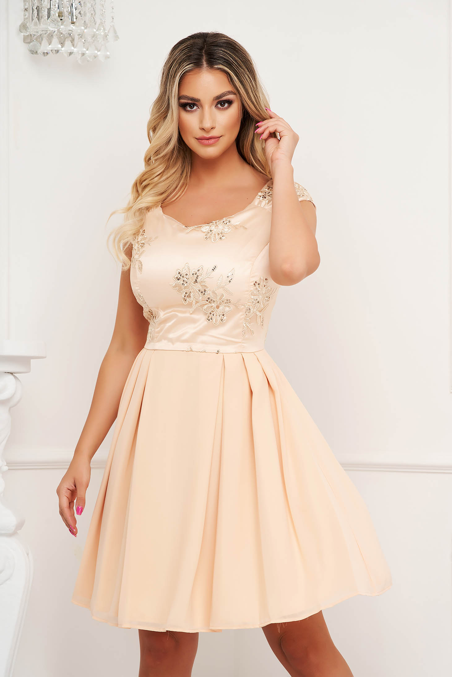 Cream dress cloche with lace details from satin fabric texture occasional short cut