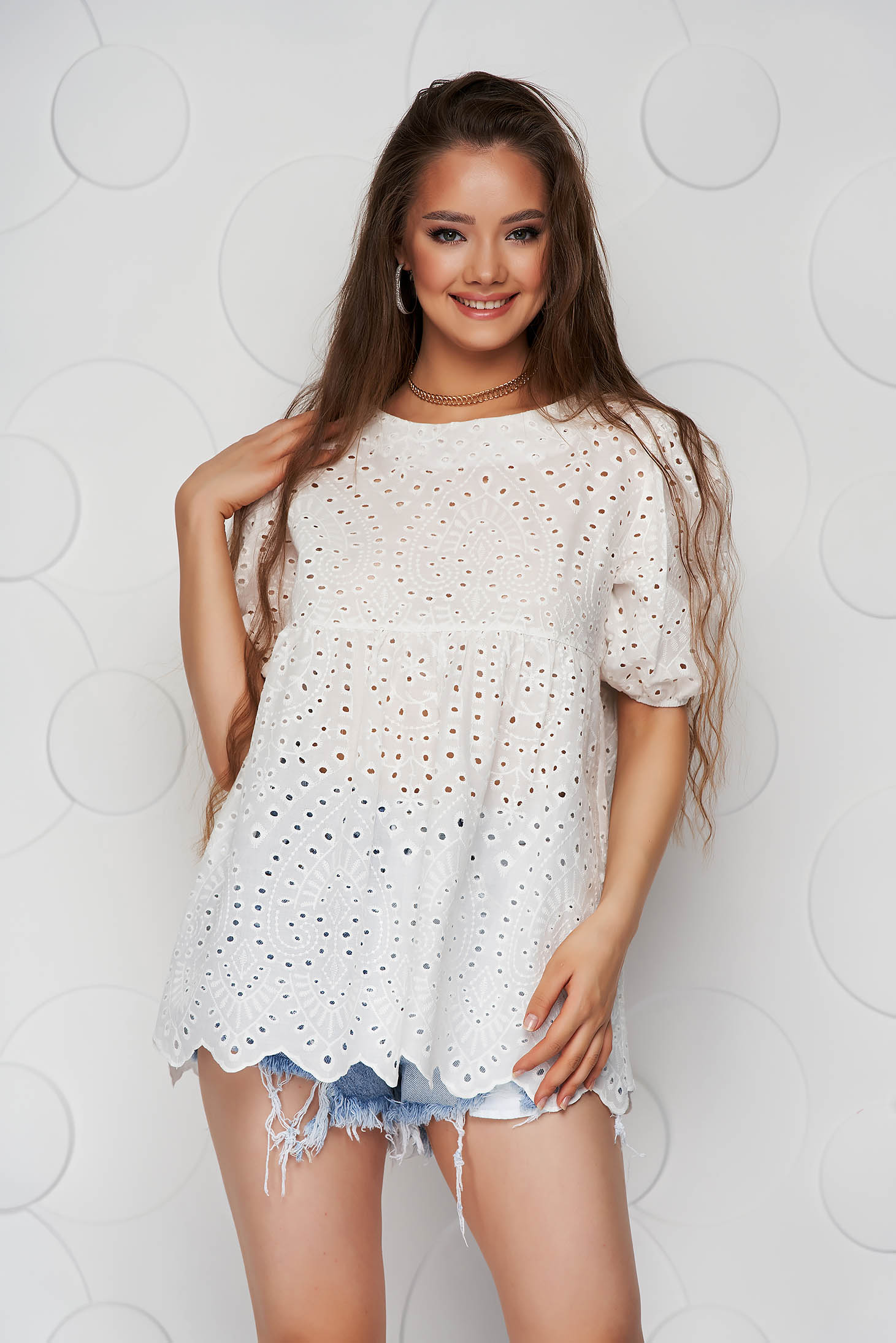 White women`s blouse guipure loose fit with rounded cleavage