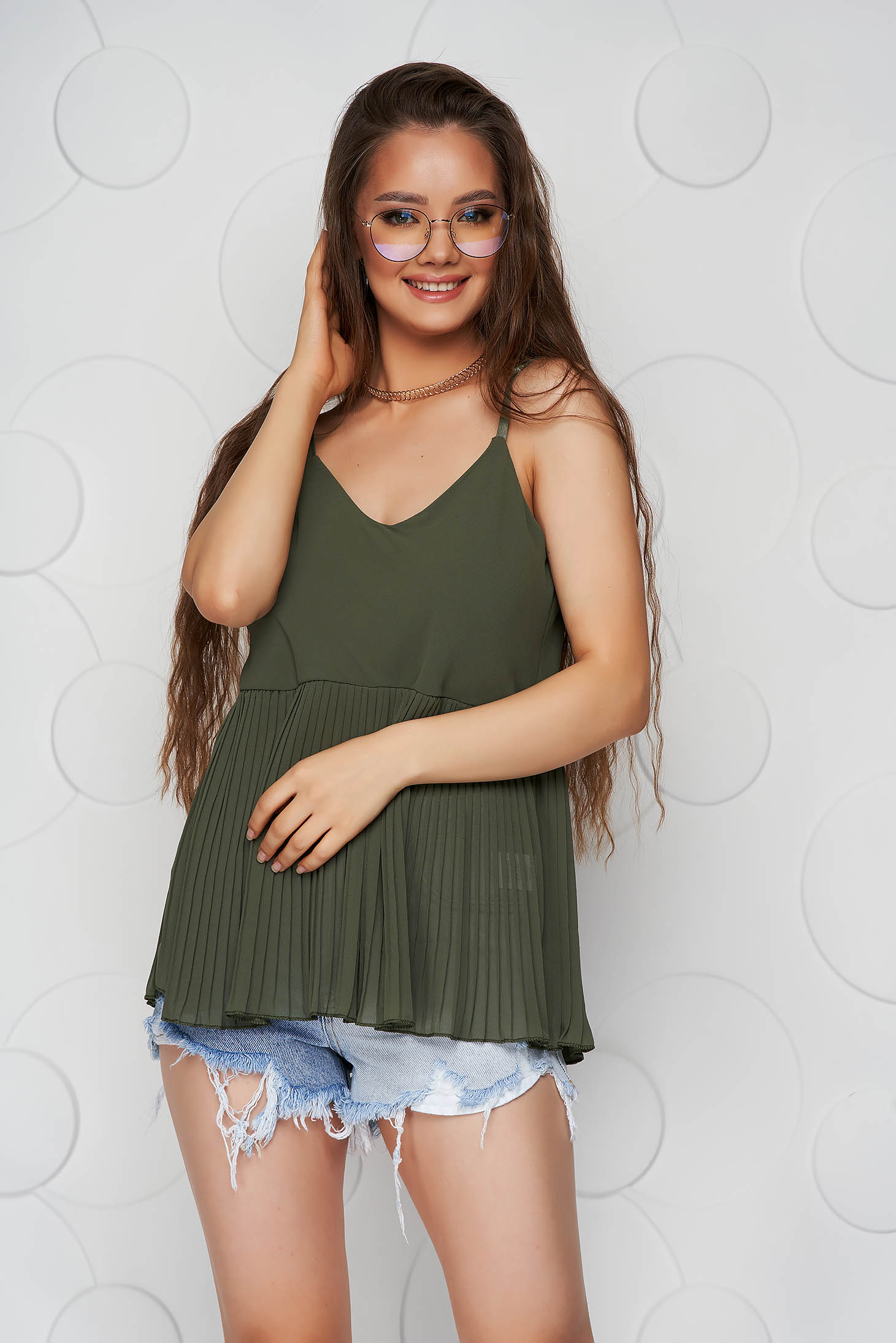 Khaki top shirt loose fit folded up from veil fabric with straps