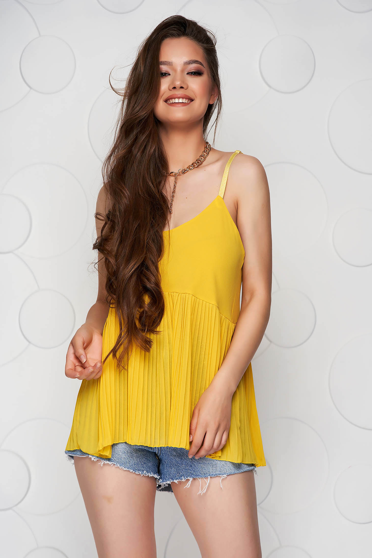 Yellow top shirt loose fit folded up from veil fabric with straps