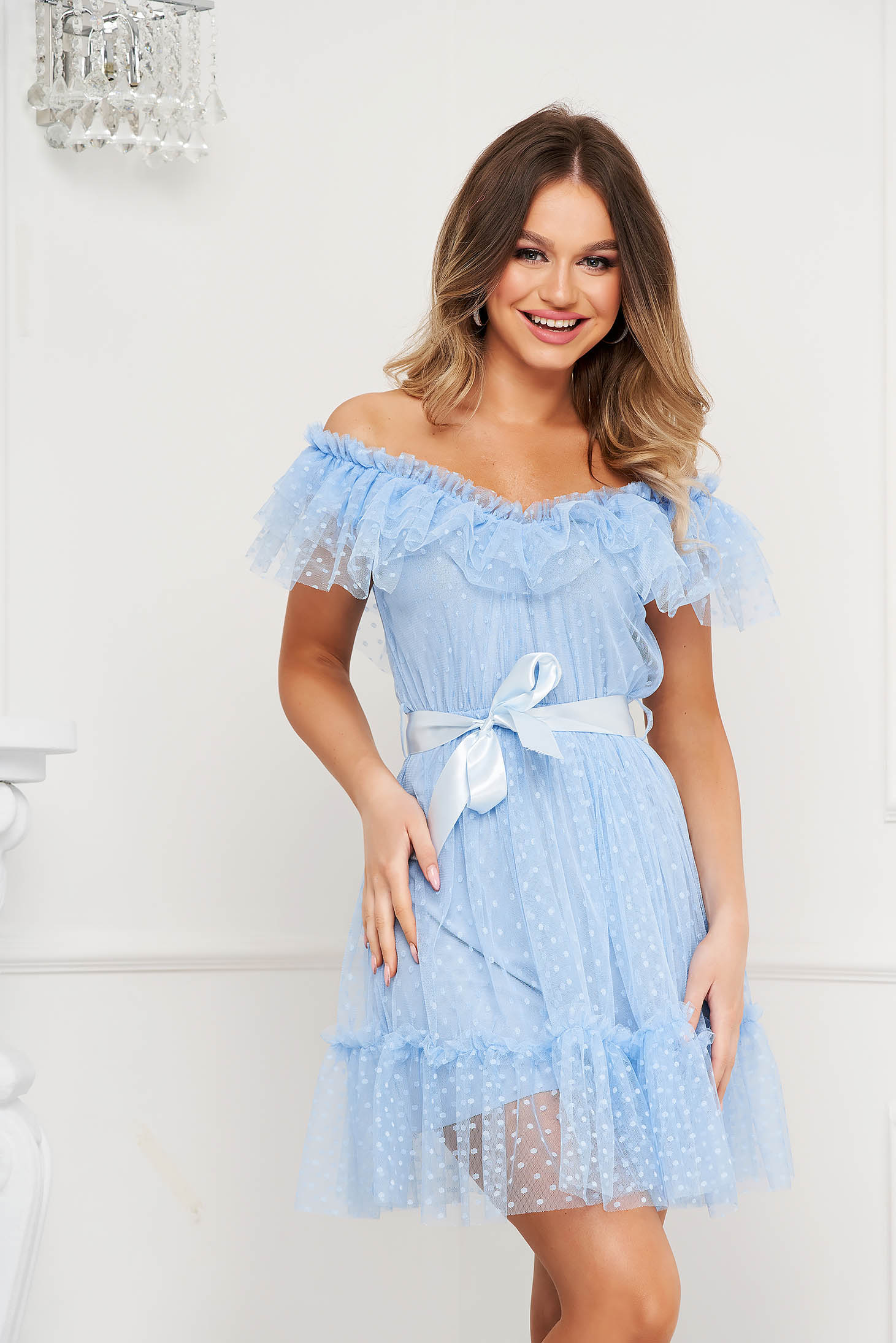 Lightblue dress from tulle cloche with elastic waist plumeti on the shoulders accessorized with tied waistband occasional