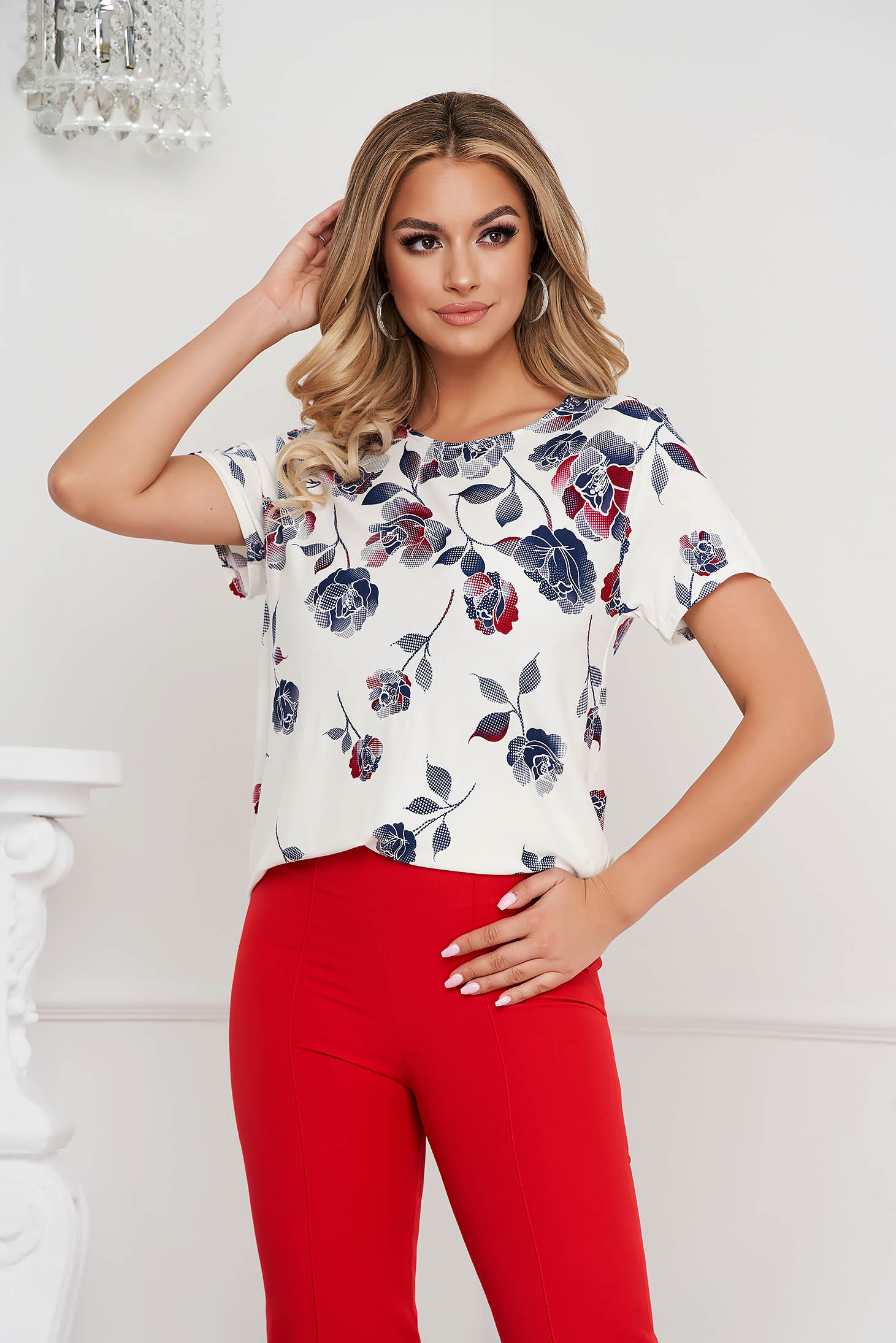 Women`s blouse loose fit from elastic fabric with floral print