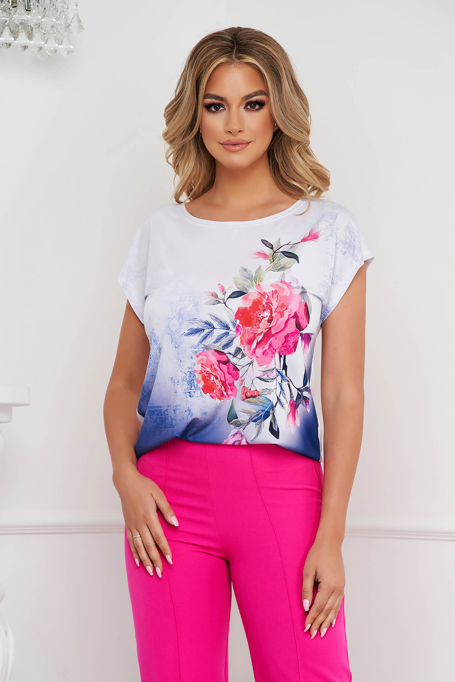 Women`s blouse with floral print from elastic and fine fabric loose fit with rounded cleavage